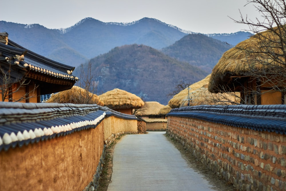 brown wooden houses surrounded by mountains