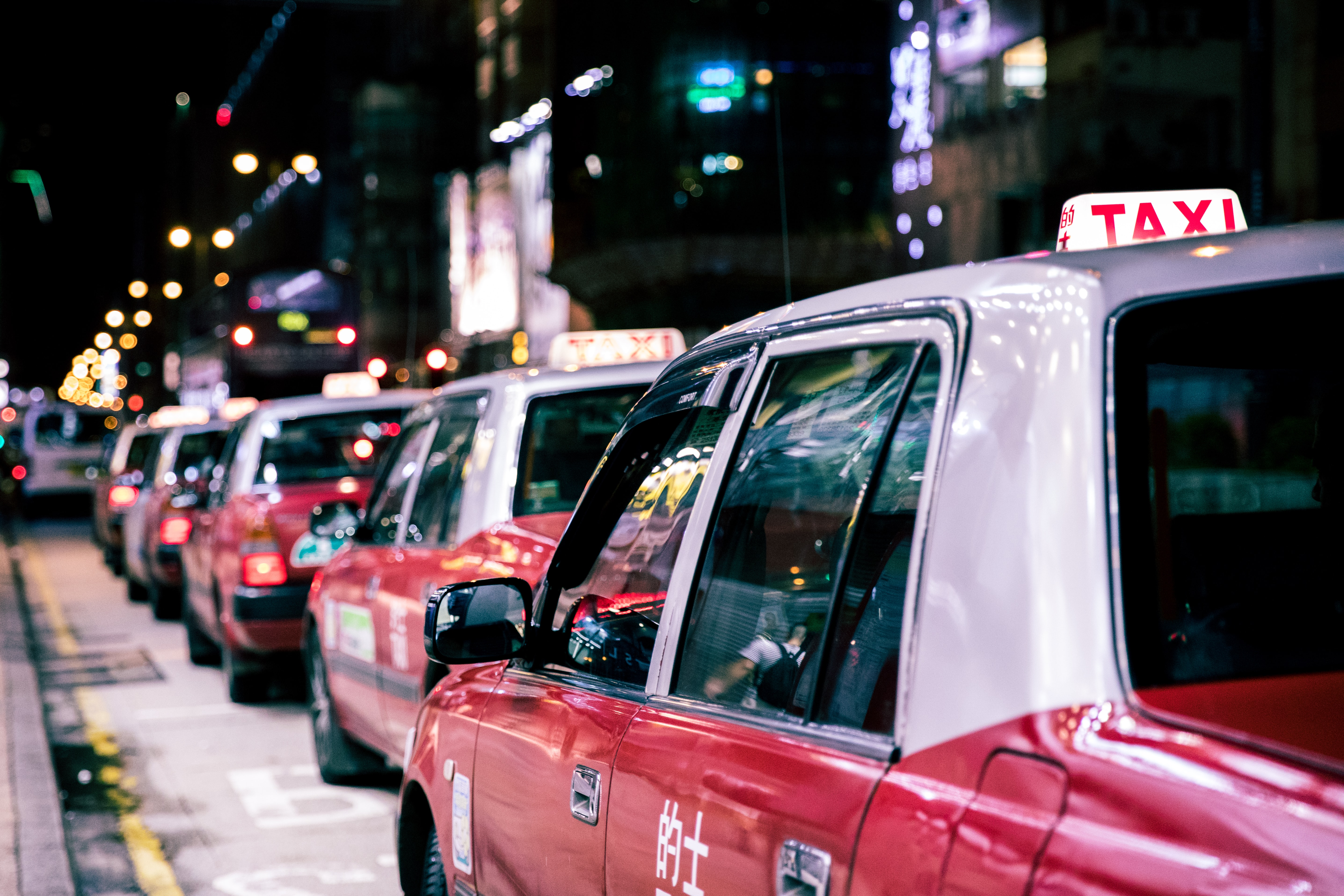red taxis on road during nighttime