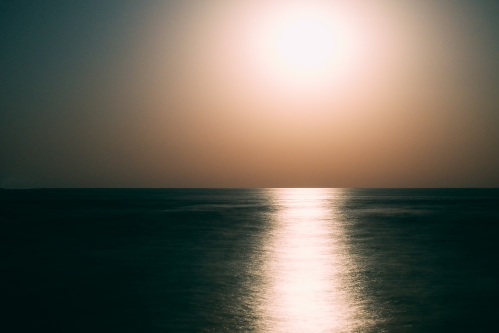Horizon wallpaper pictures download free images on unsplash calm body of water during day time altavistaventures Gallery