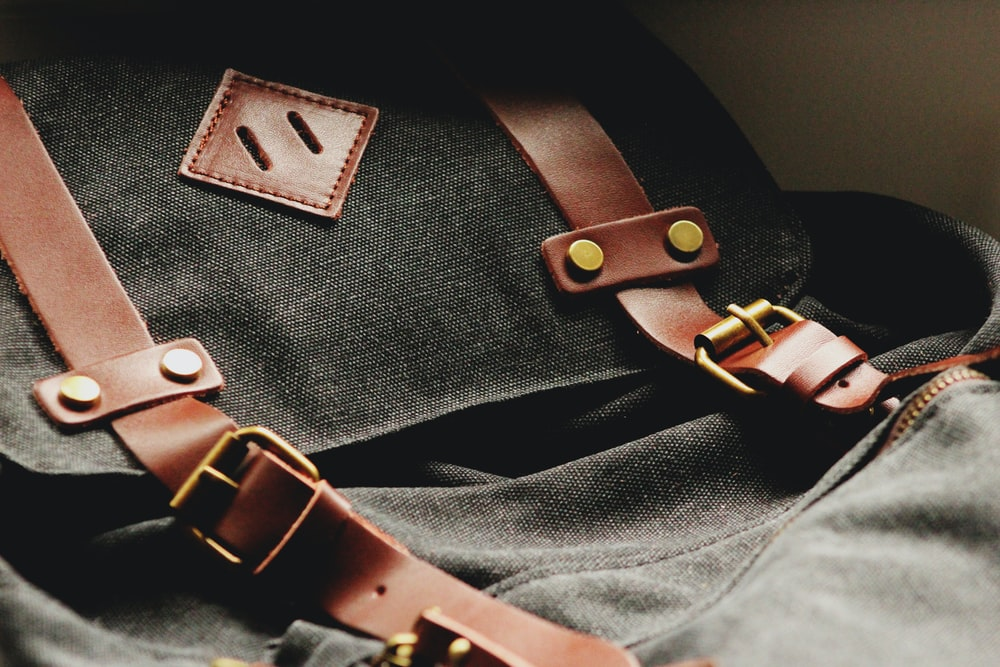 shallow focus photography of black rucksack