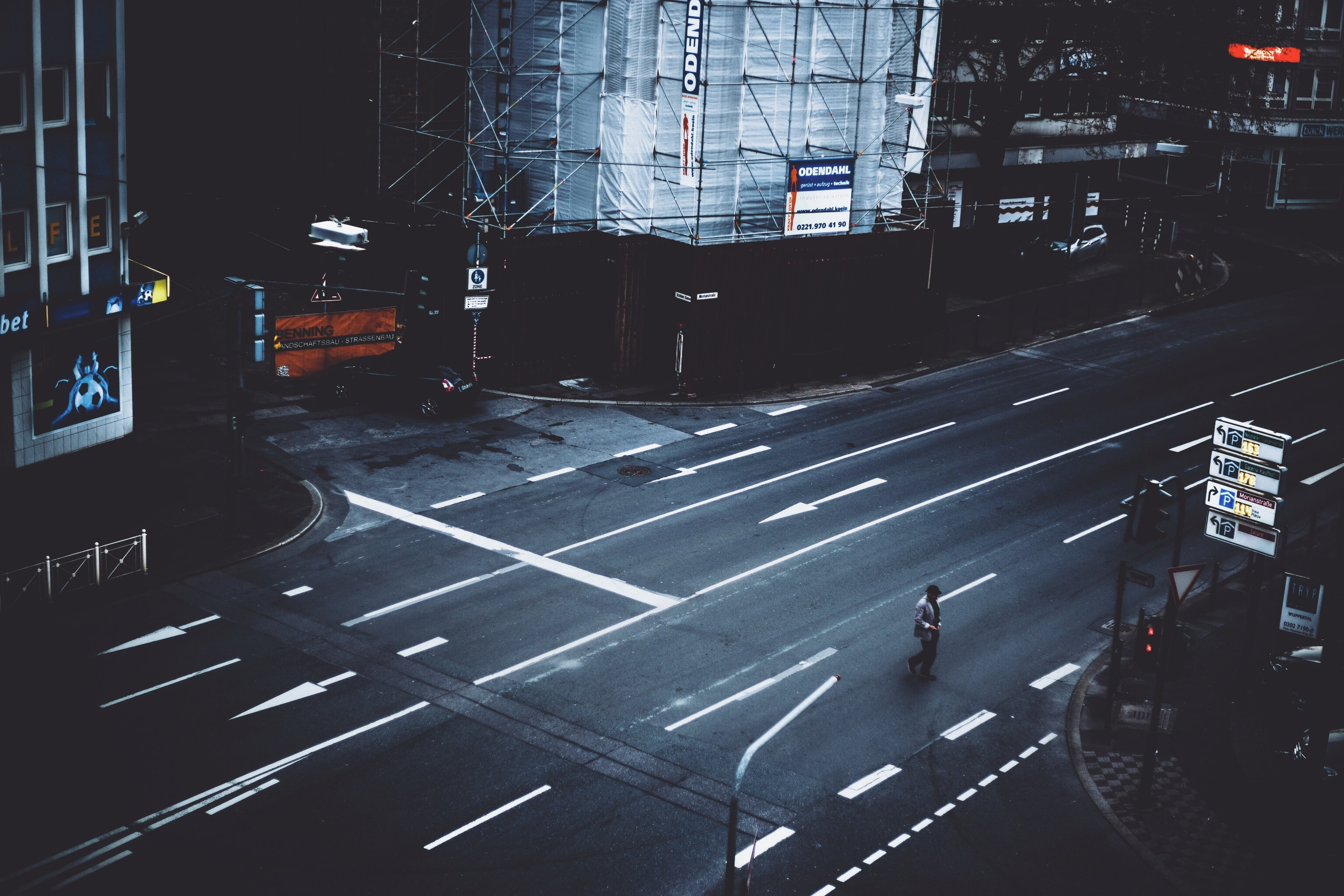 person walking in road near building during daytime