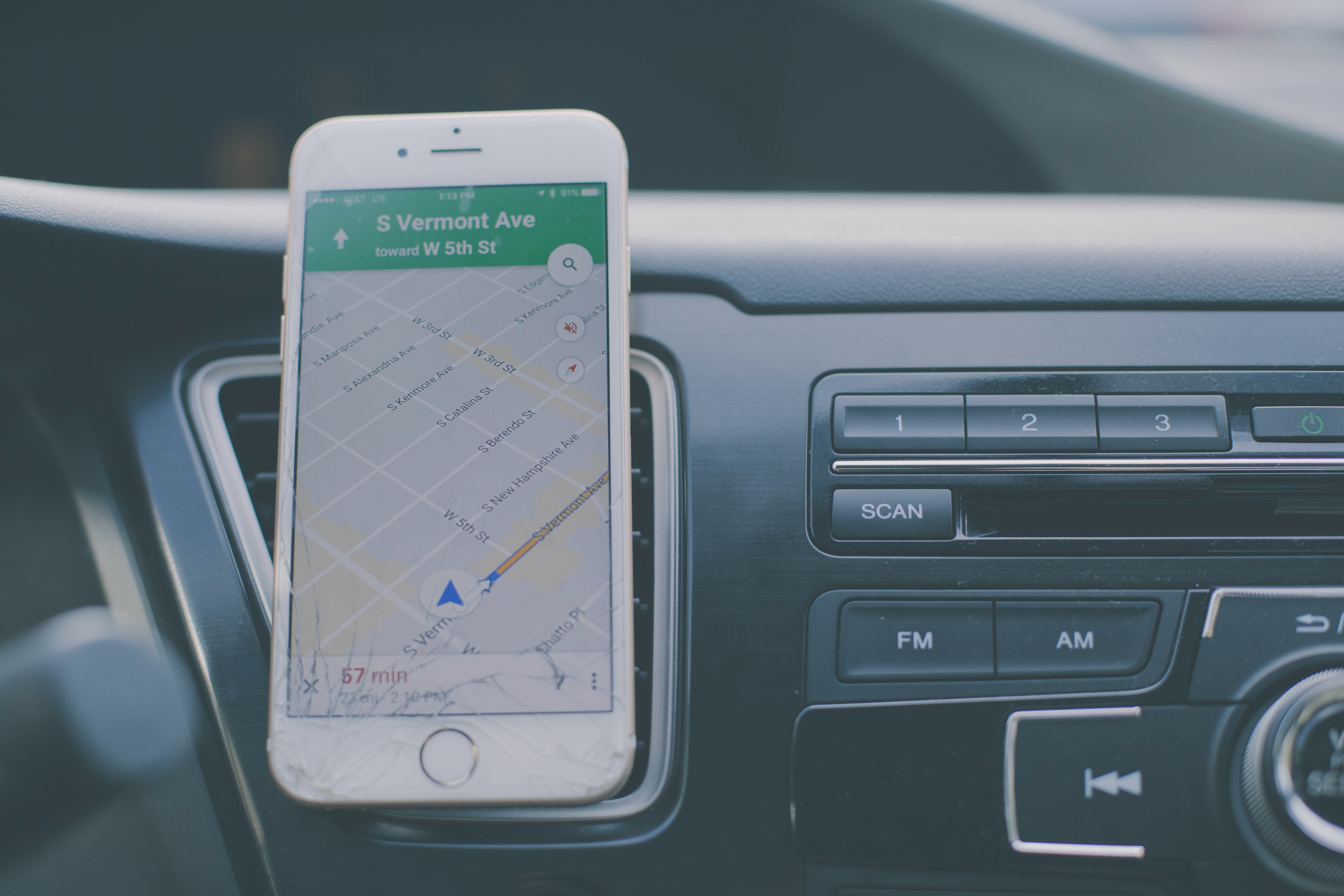 silver iPhone 6 on front of car aircon