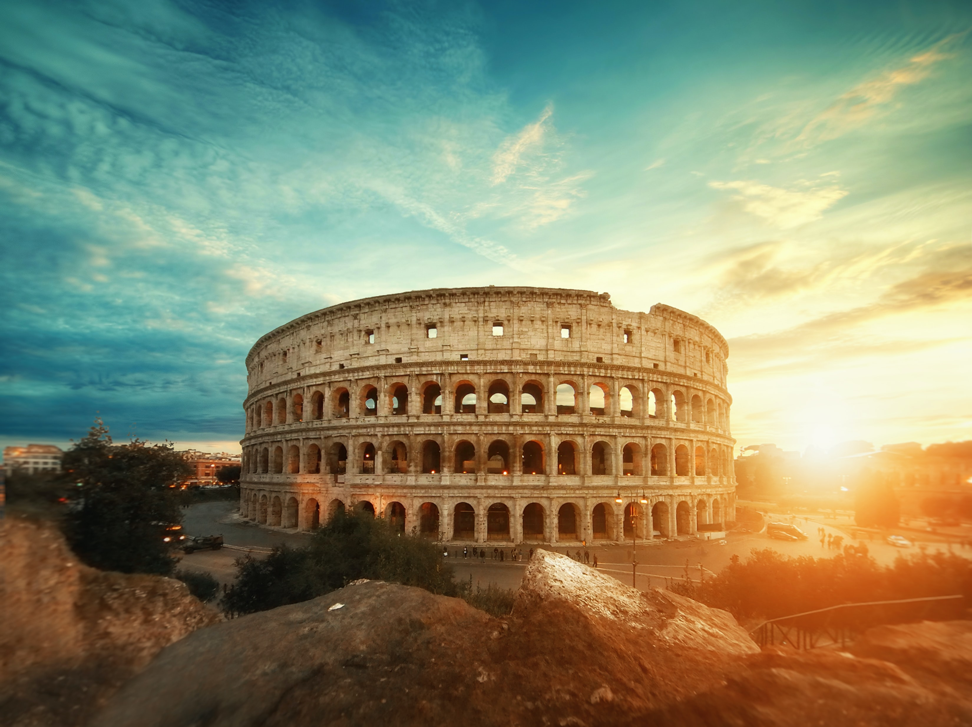 Roman Colosseum, Italy under clear sky during golden hour