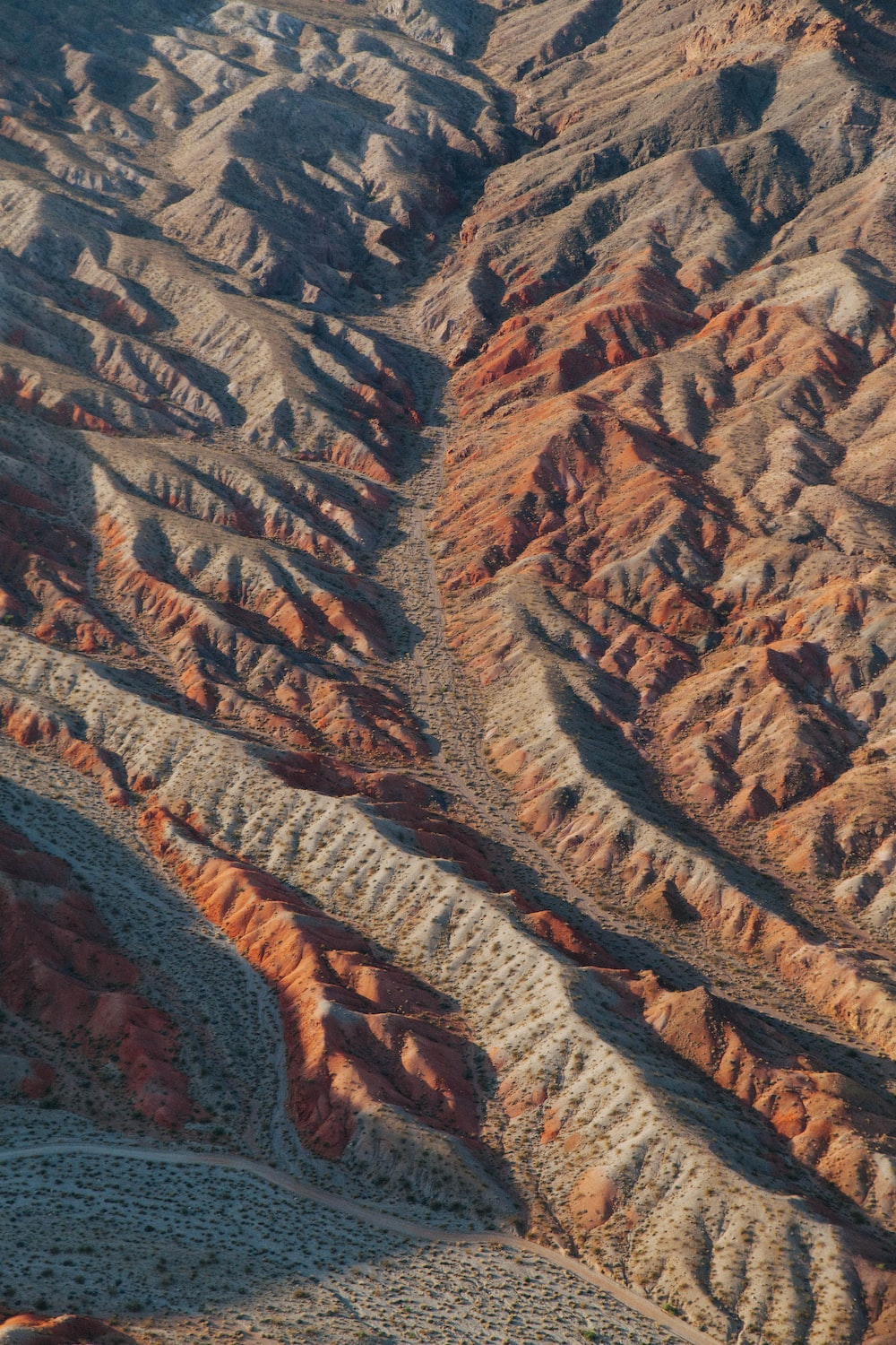 birdseye view photography of brown mountains