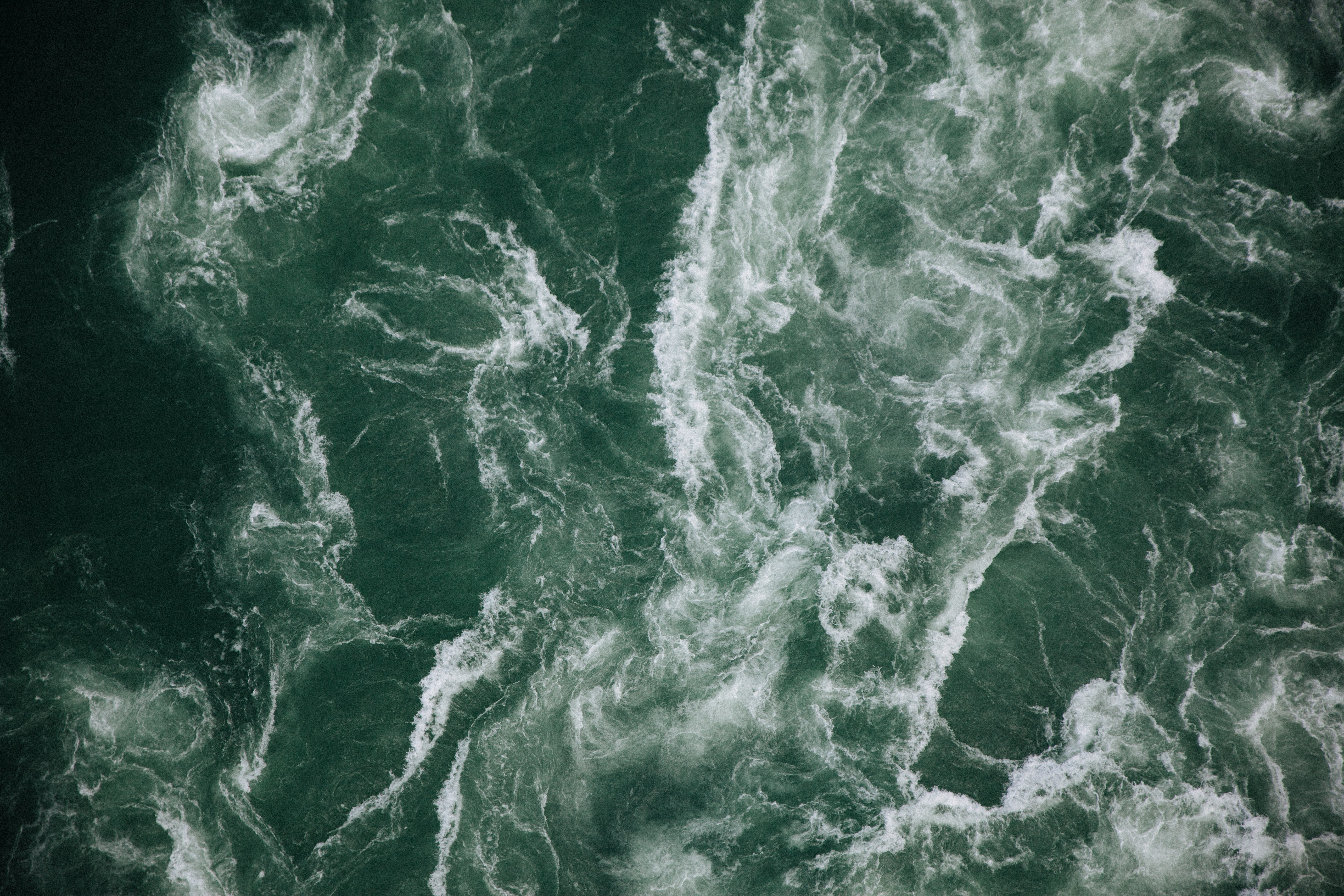 Satellite view of busy ocean waves.