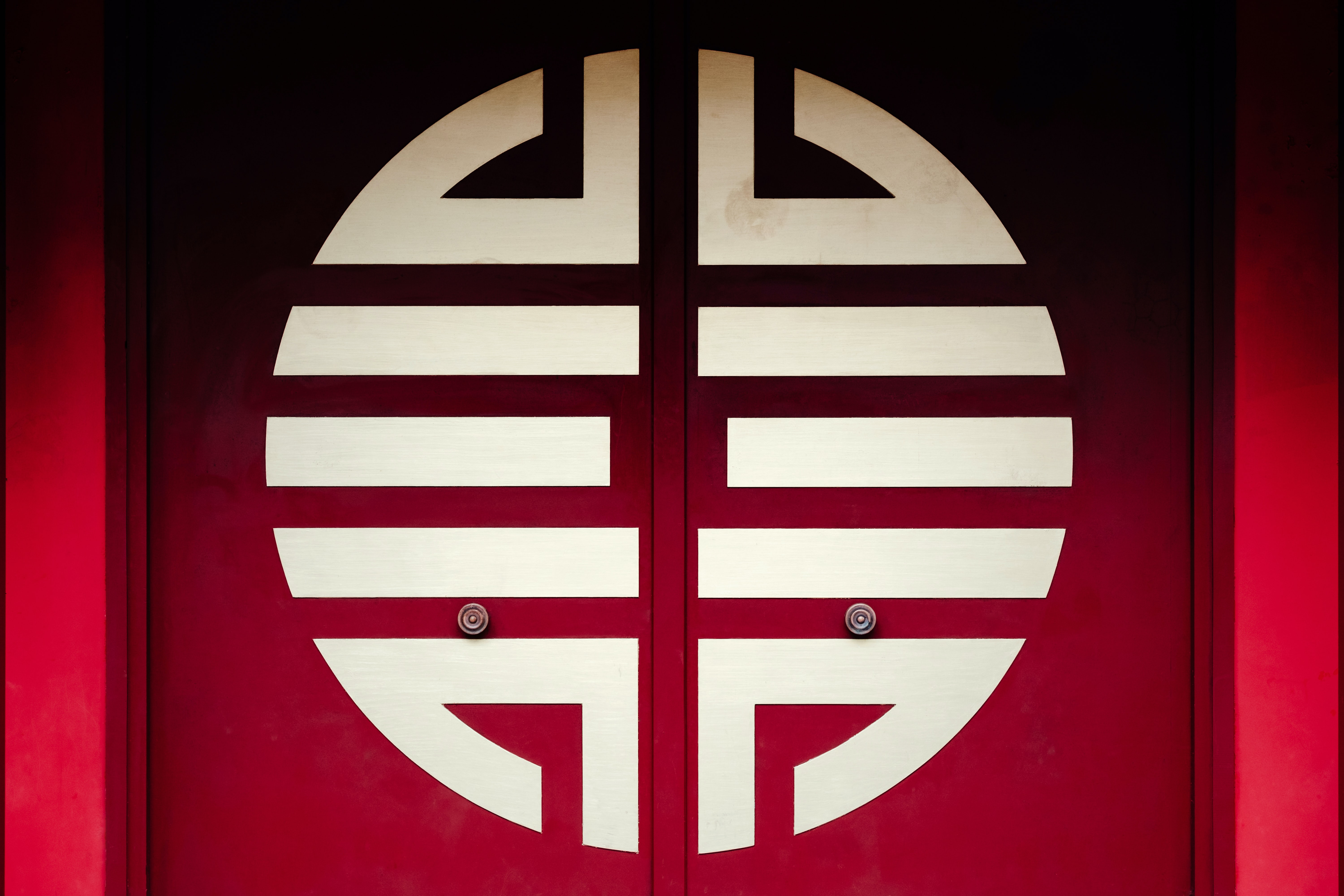 Chinese happiness symbol on red doors.