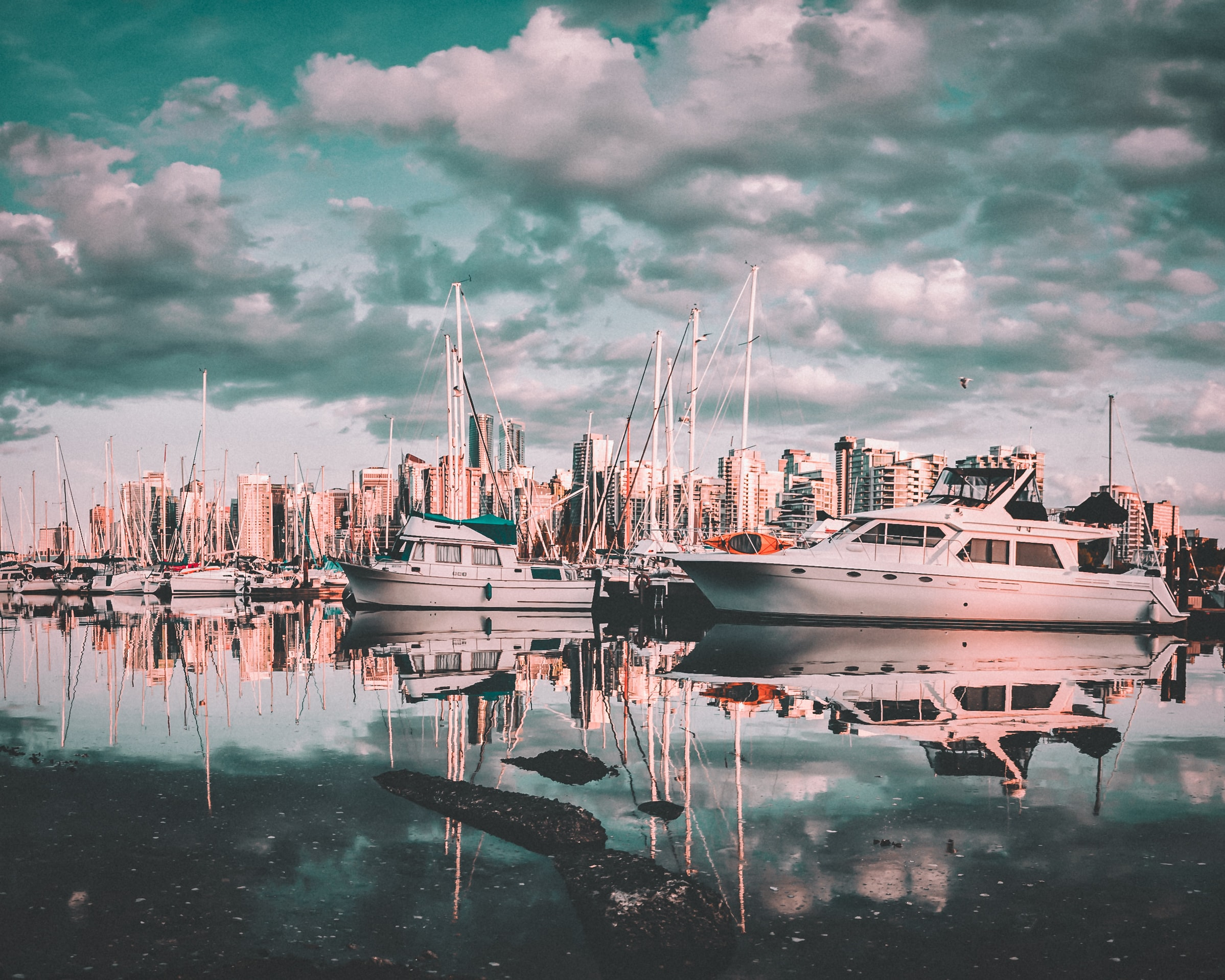 photo of sailing boats on body of water