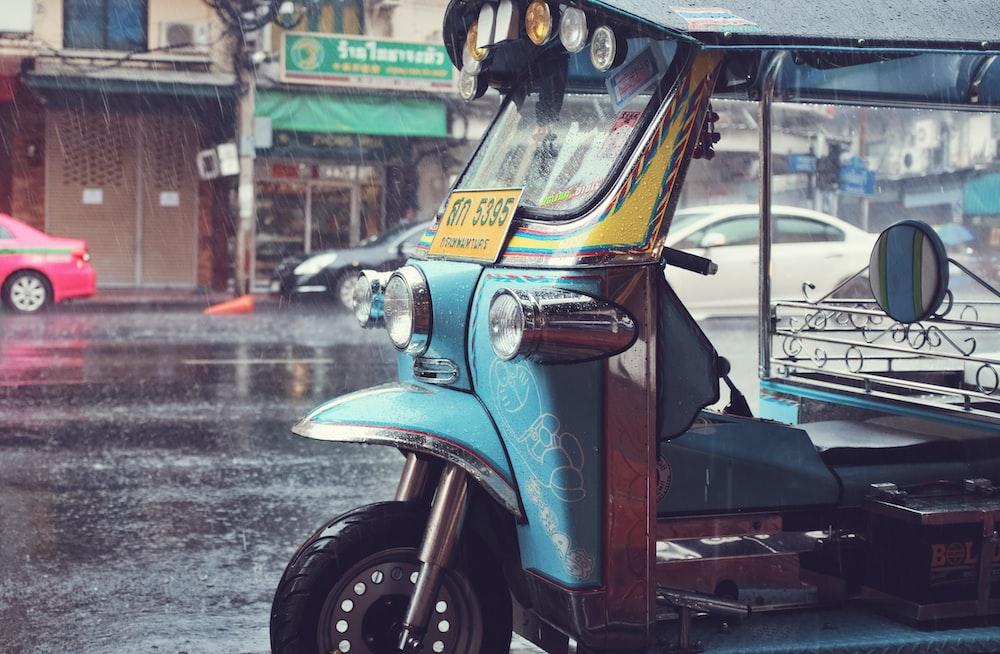 auto rickshaw outside store at raining season