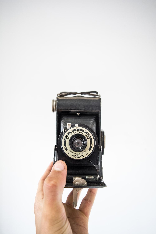 person holding black Kodak camera
