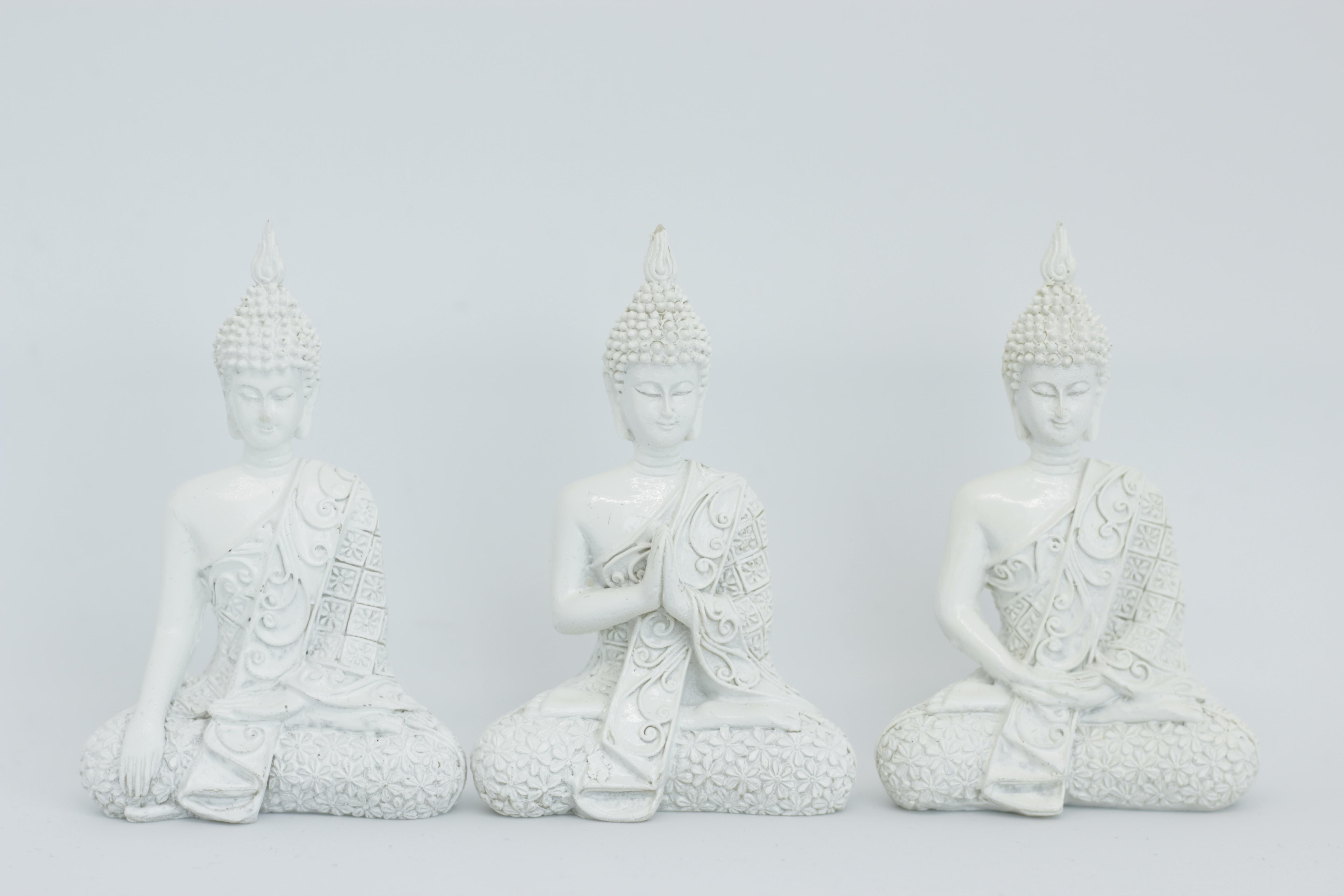 three Gautama Buddah ceramic figurines