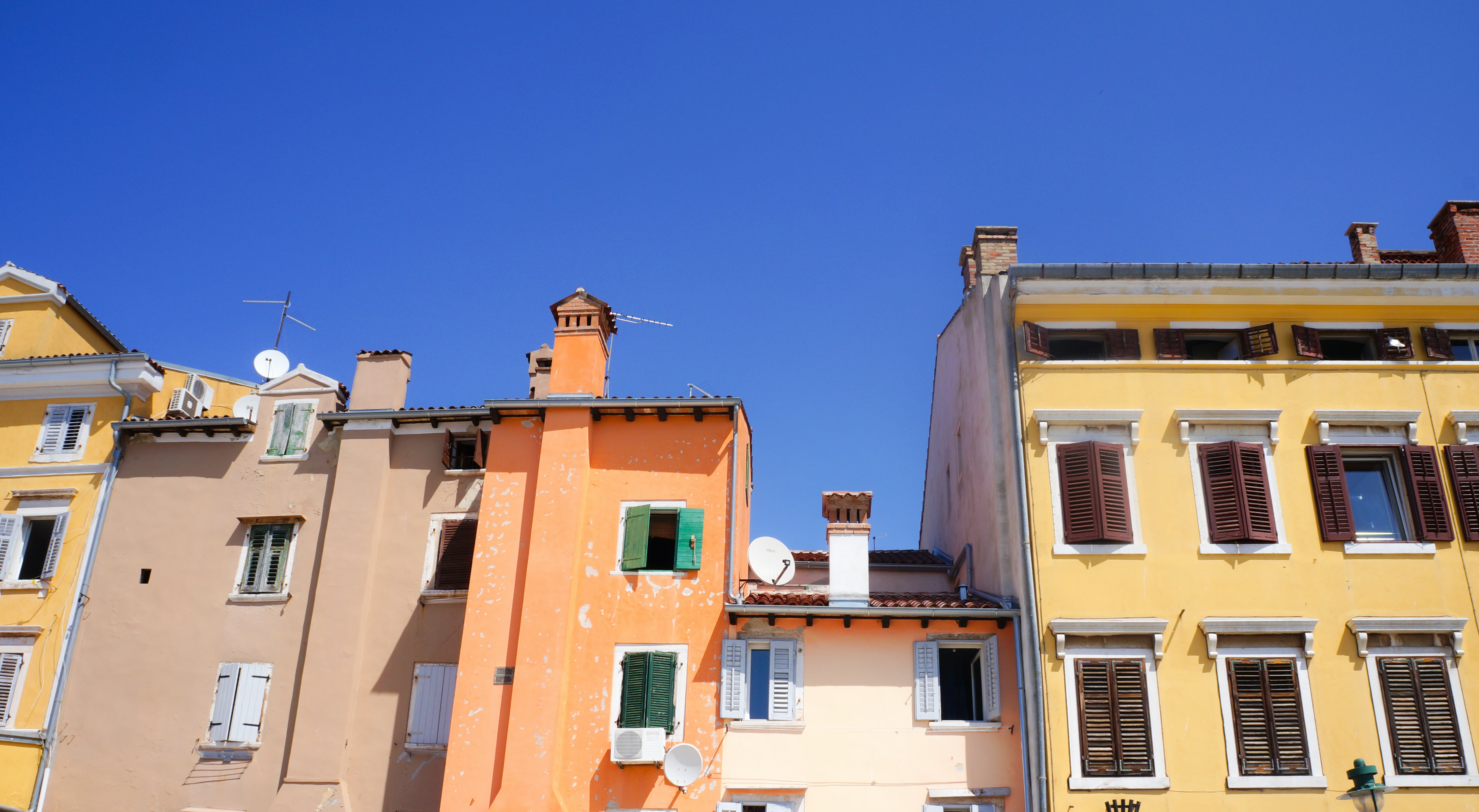 yellow and orange concrete buildings under blue sky during daytime