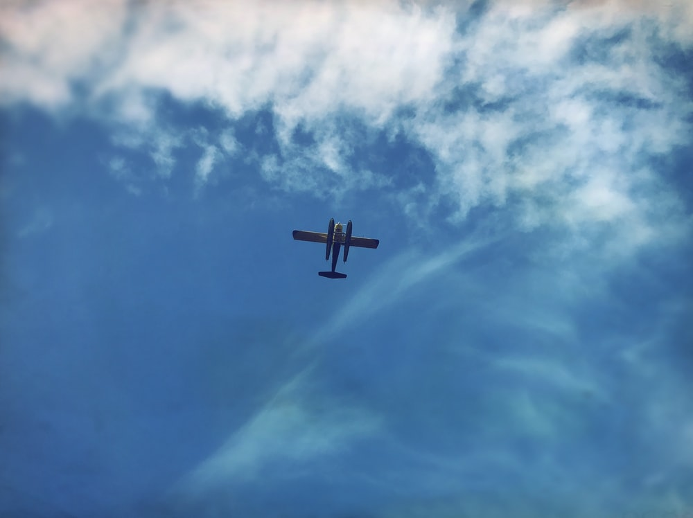 worm's eyeview photo of white biplane