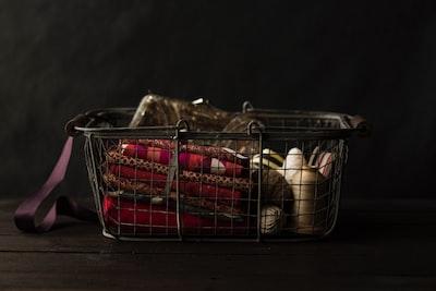 red textile on black steel basket