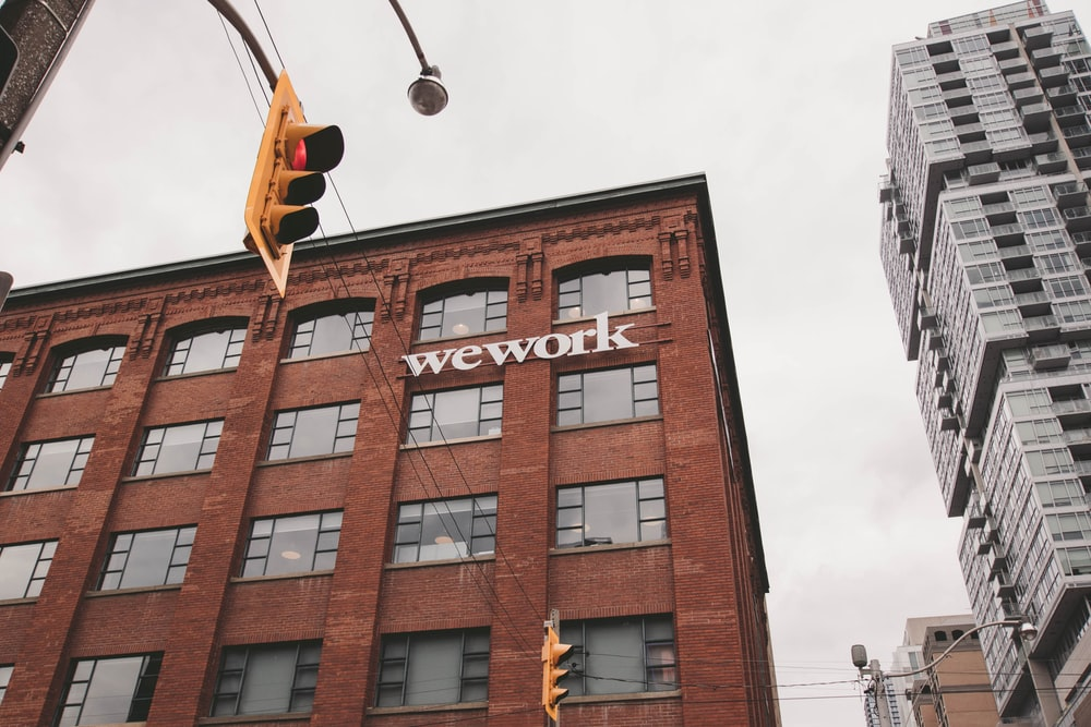 Wework building beside traffic light during daytime
