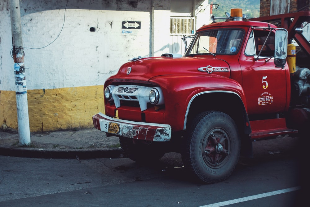 red firetruck on road during daytime