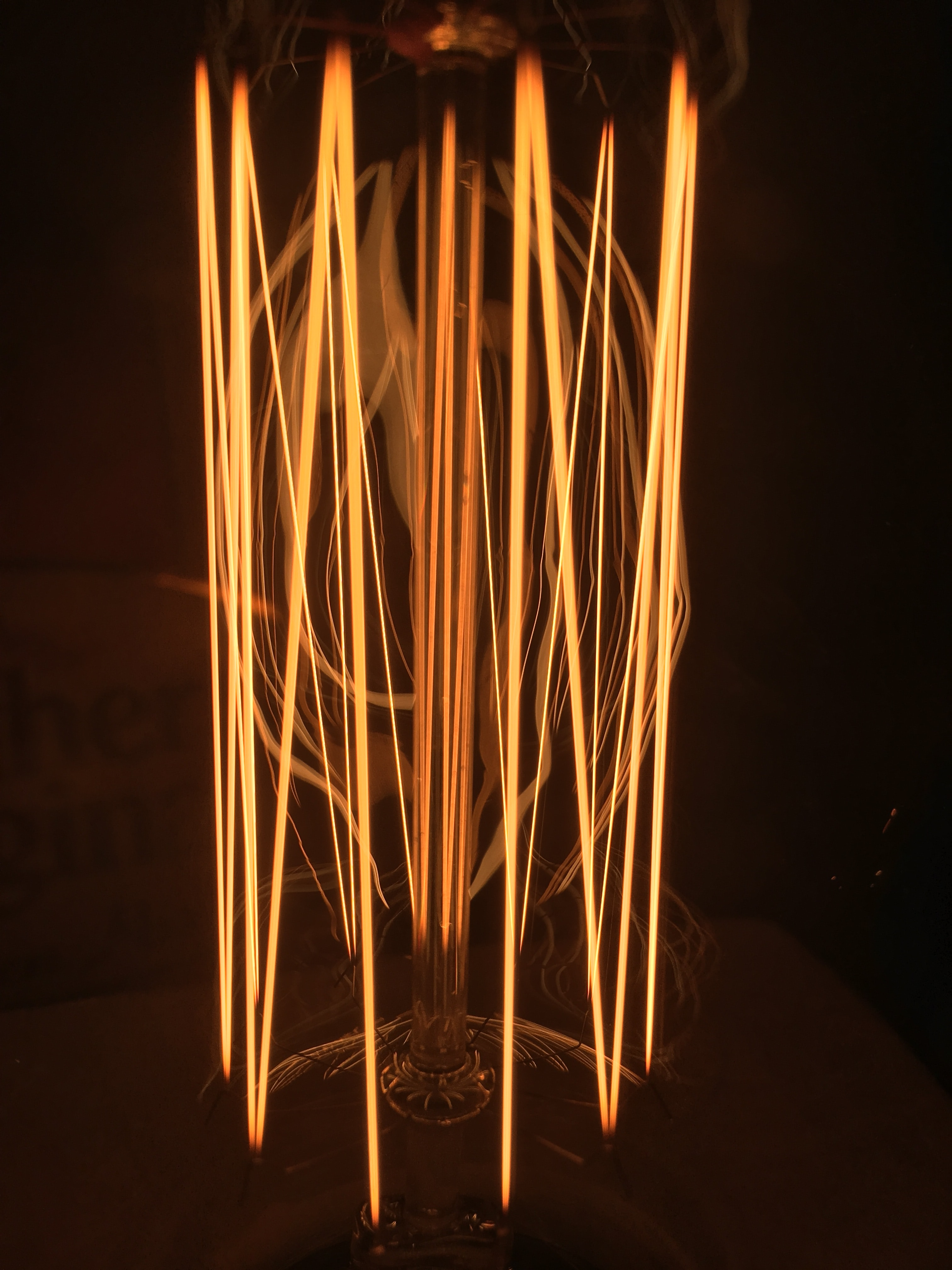 closeup photo of turned on filament bulb