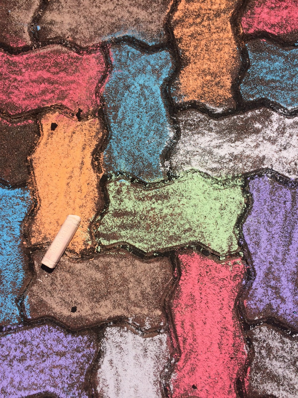 close-up photo of multicolored dumble brick pavement