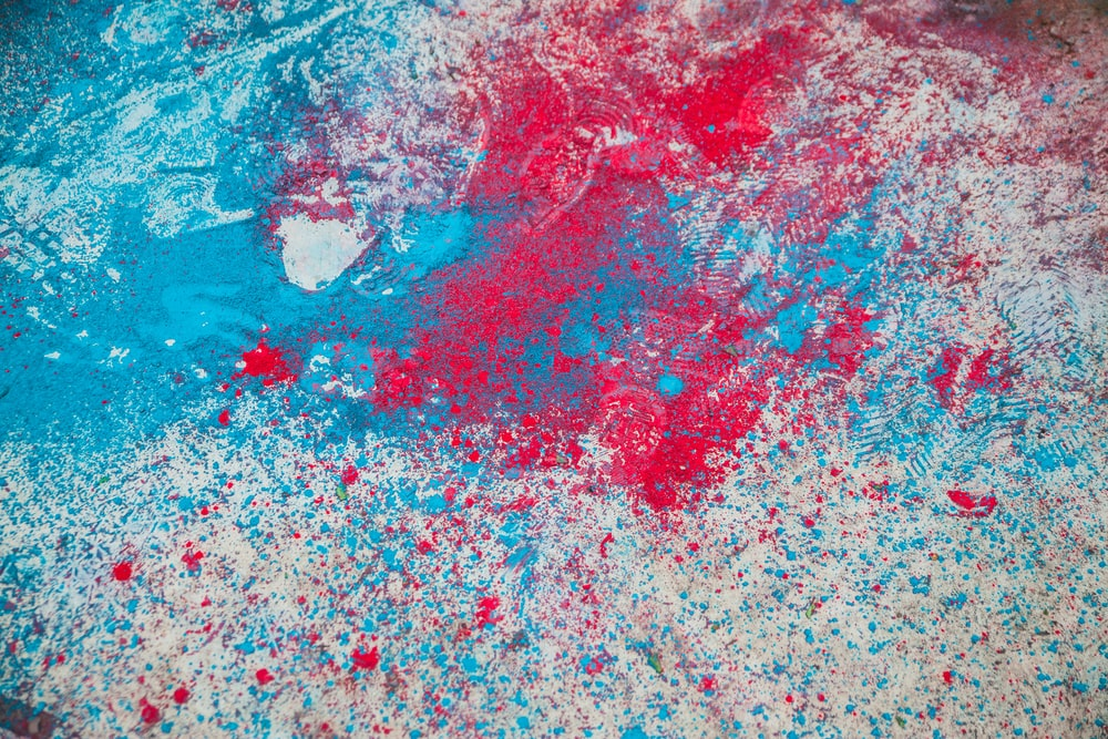 red and multicolored paint splatters