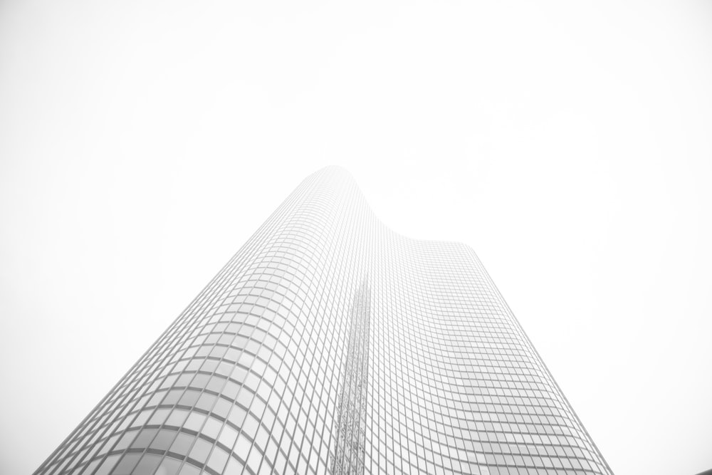 glass building under gray sky during daytime