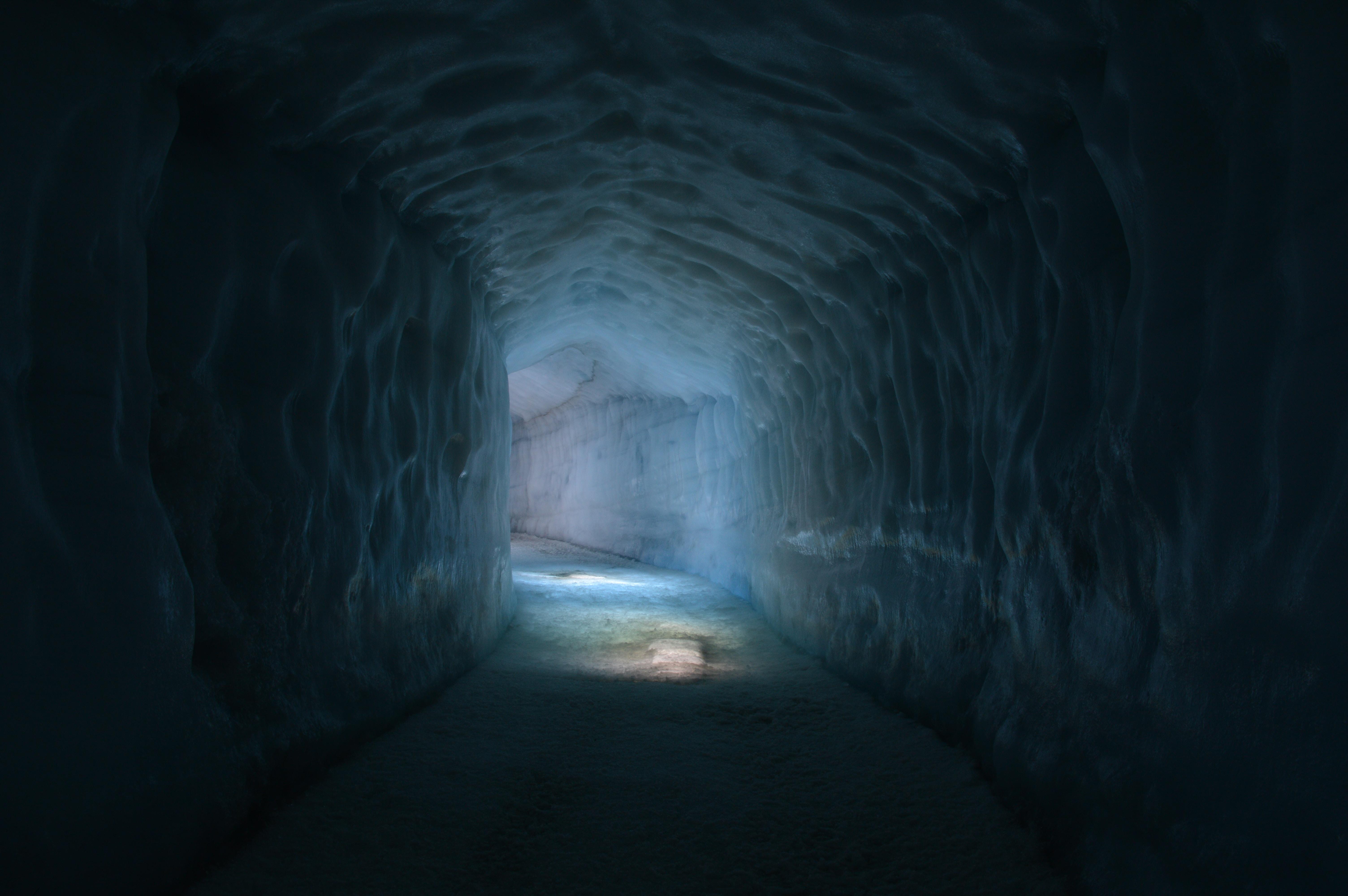A poorly lit underground tunnel.