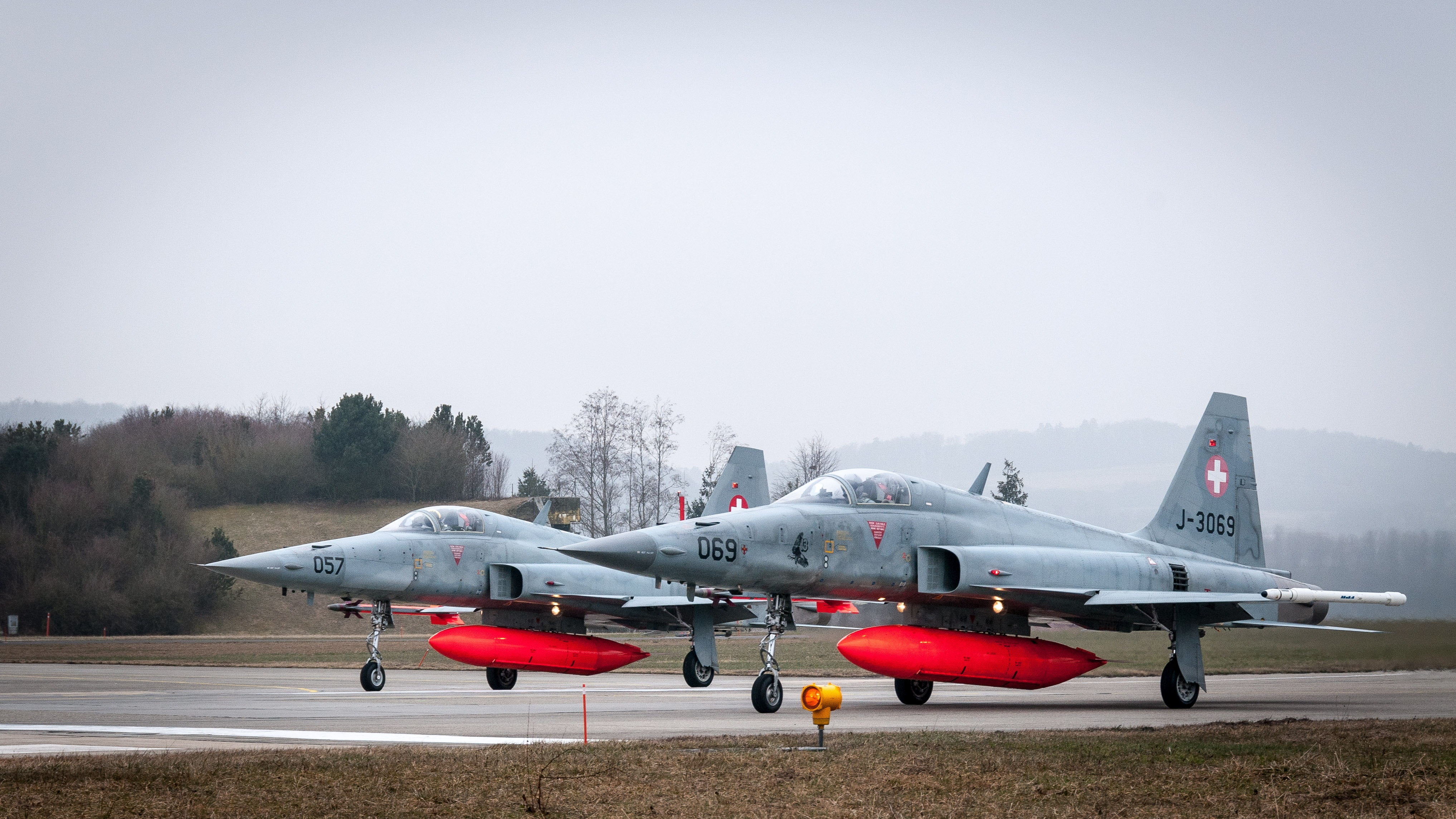 two gray jet fighters