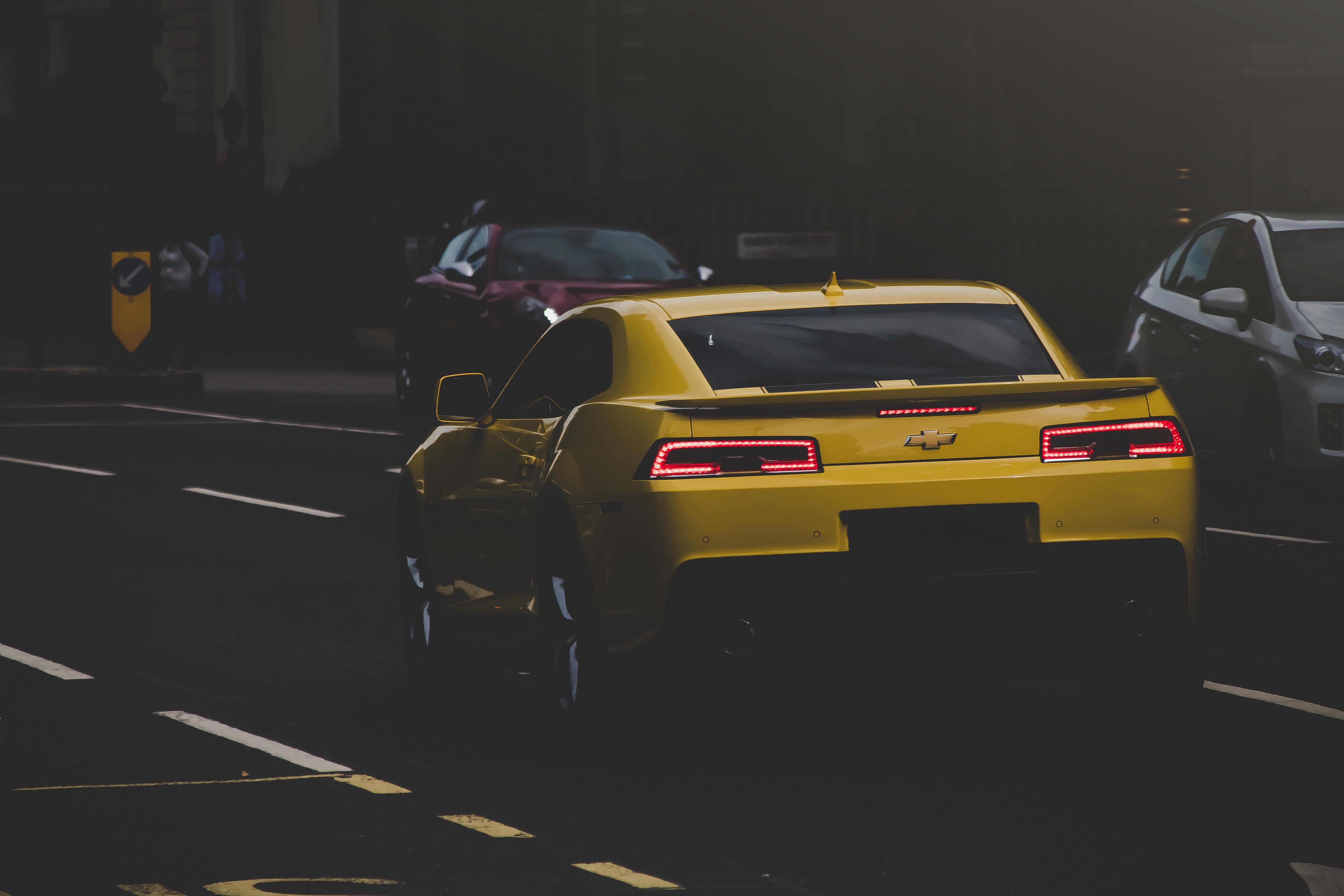 yellow Chevrolet Camaro on road