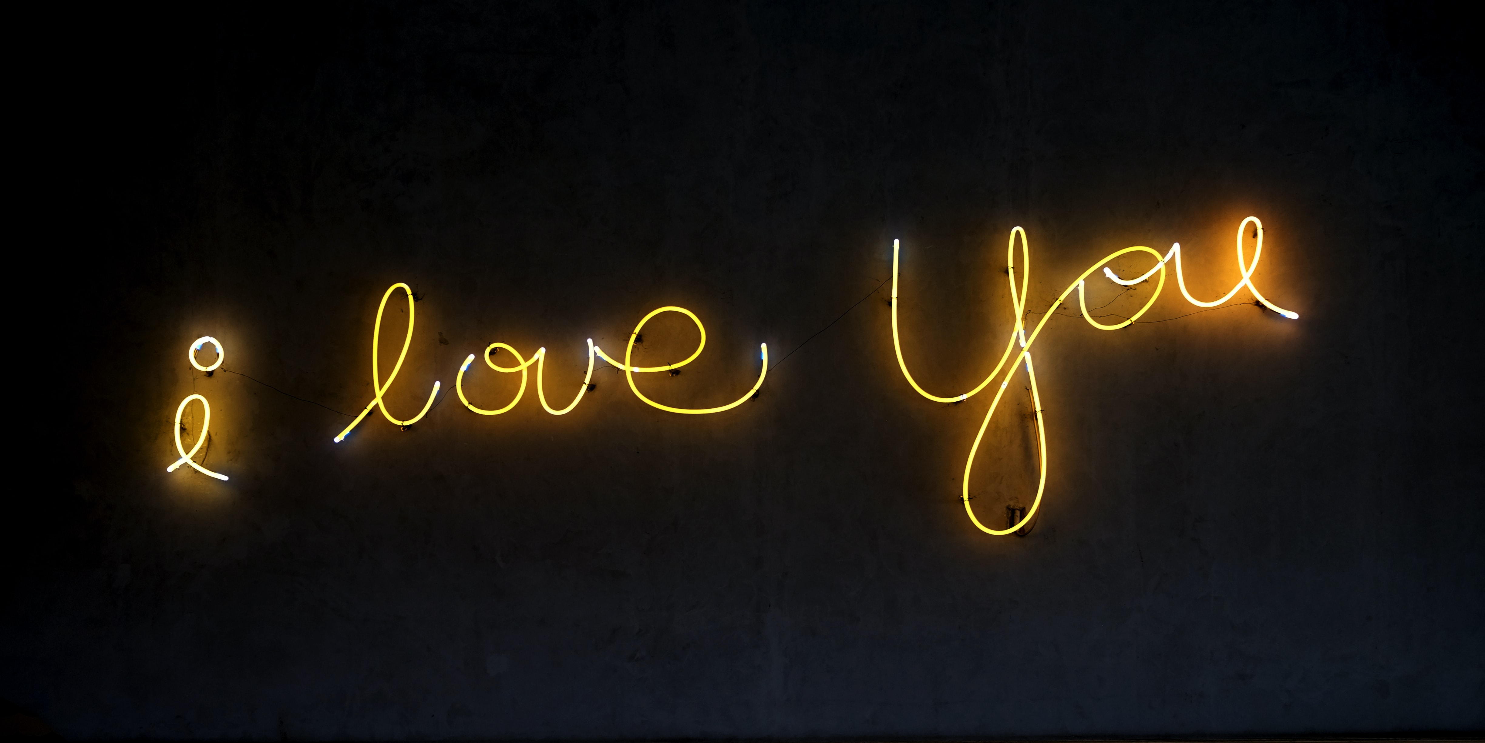"Yellow neon lights that say ""I love you."""