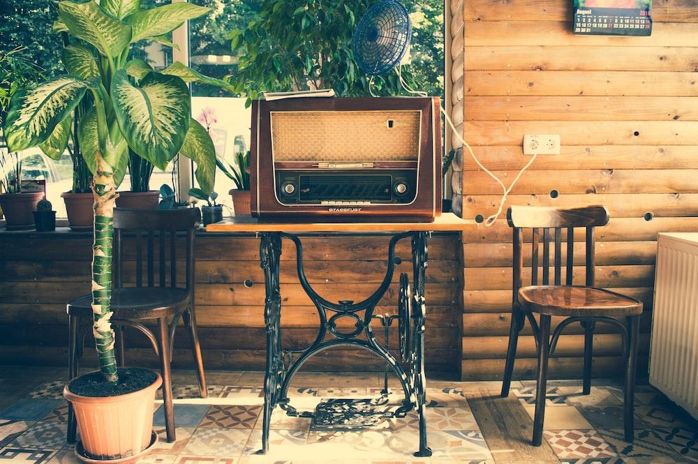 vointage brown radio on black wooden table