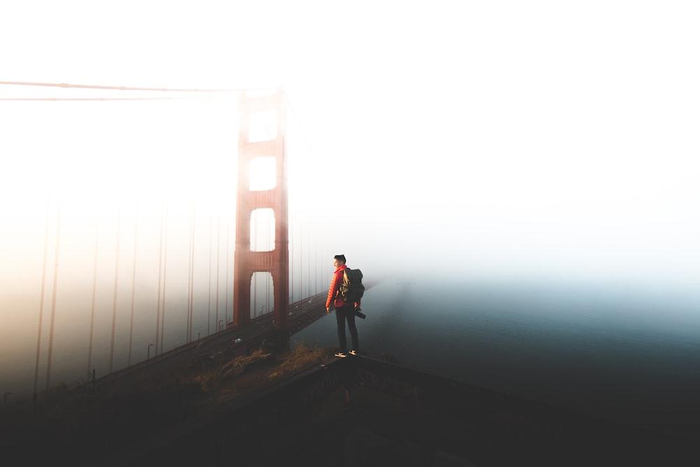 man standing near Golden Gate bridghe