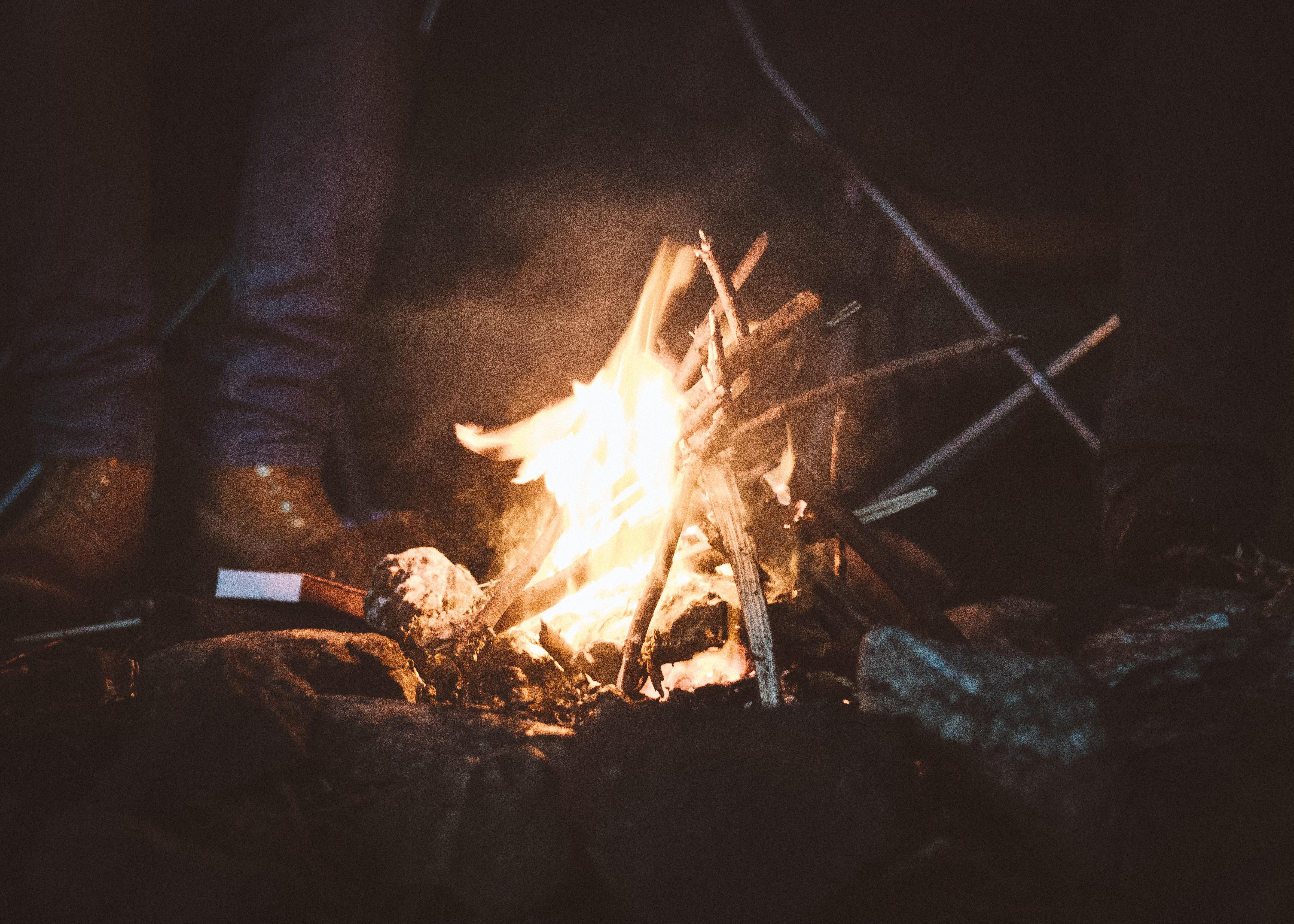 person standing near campfire