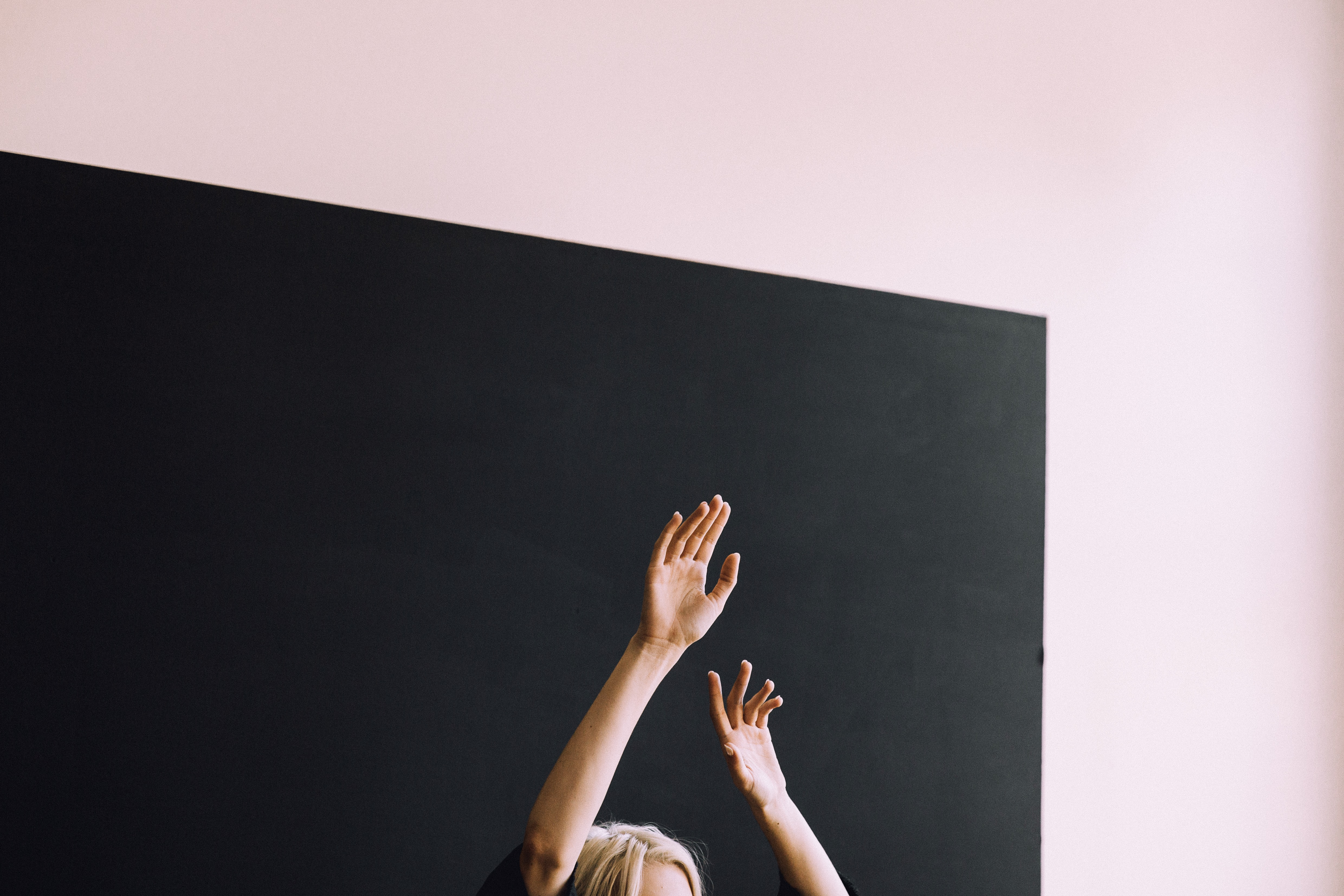 person raising both hands
