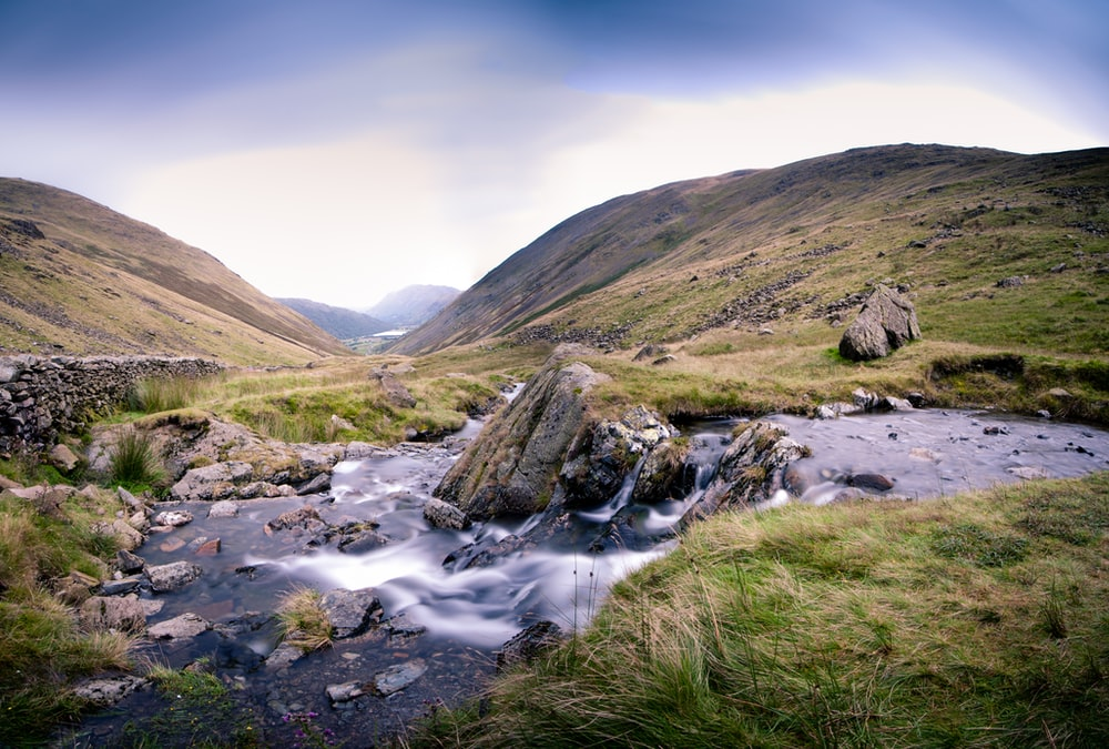 time-lapsed photography of stream during daytime