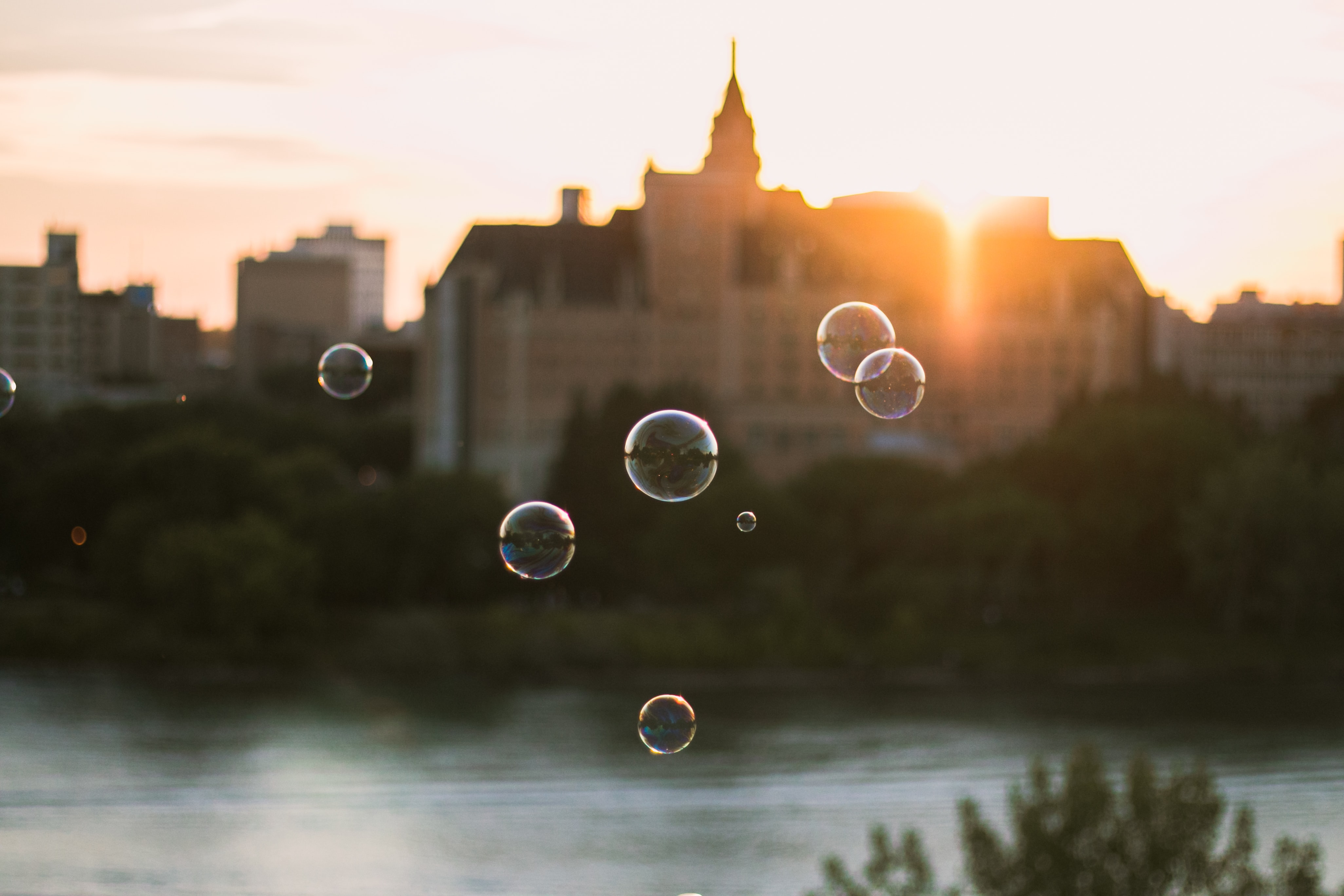 shallow focus photography of bubbles near body of water