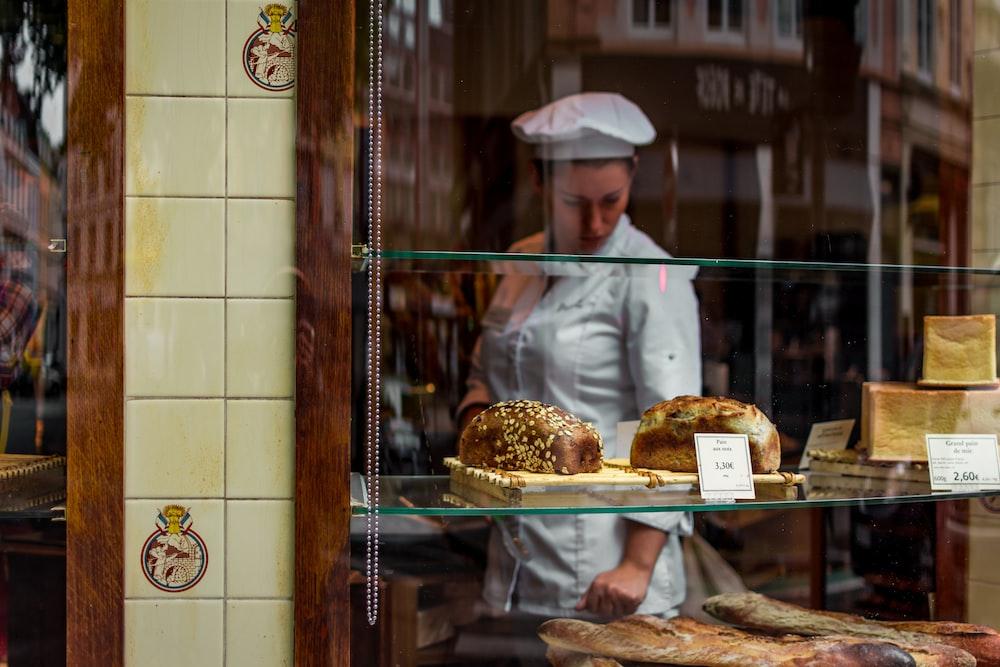 baker inside glass covered store