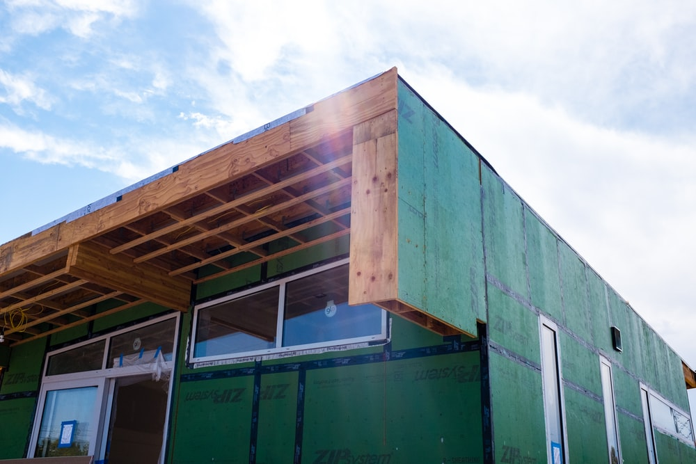 green wooden building during daytime