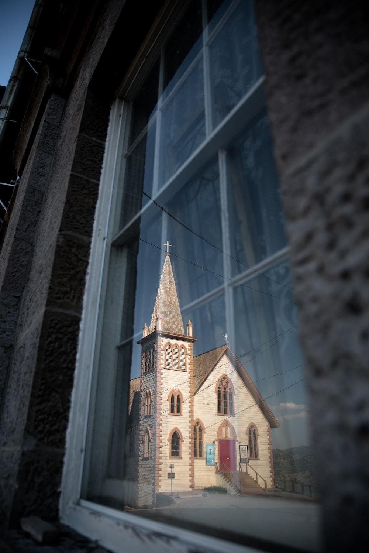 A church viewed through a window.