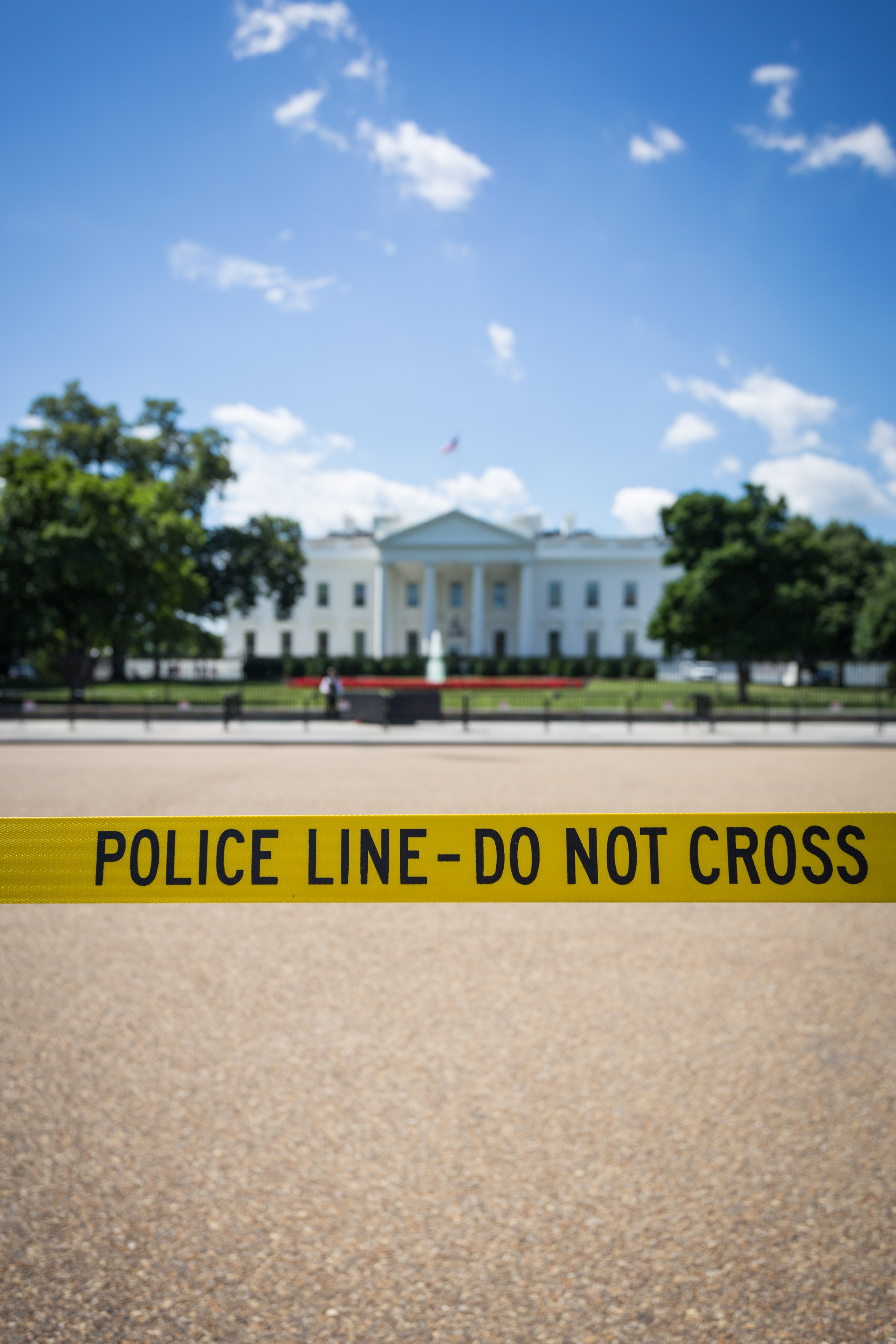 The White house in the USA taped off with police tape and a blue sky