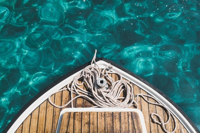 aerial photography of brown boat on body of water