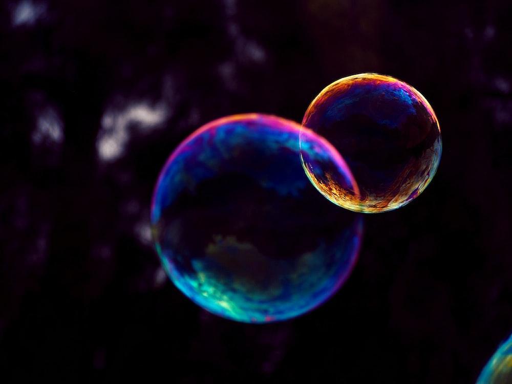 closeup photo of two bubbles