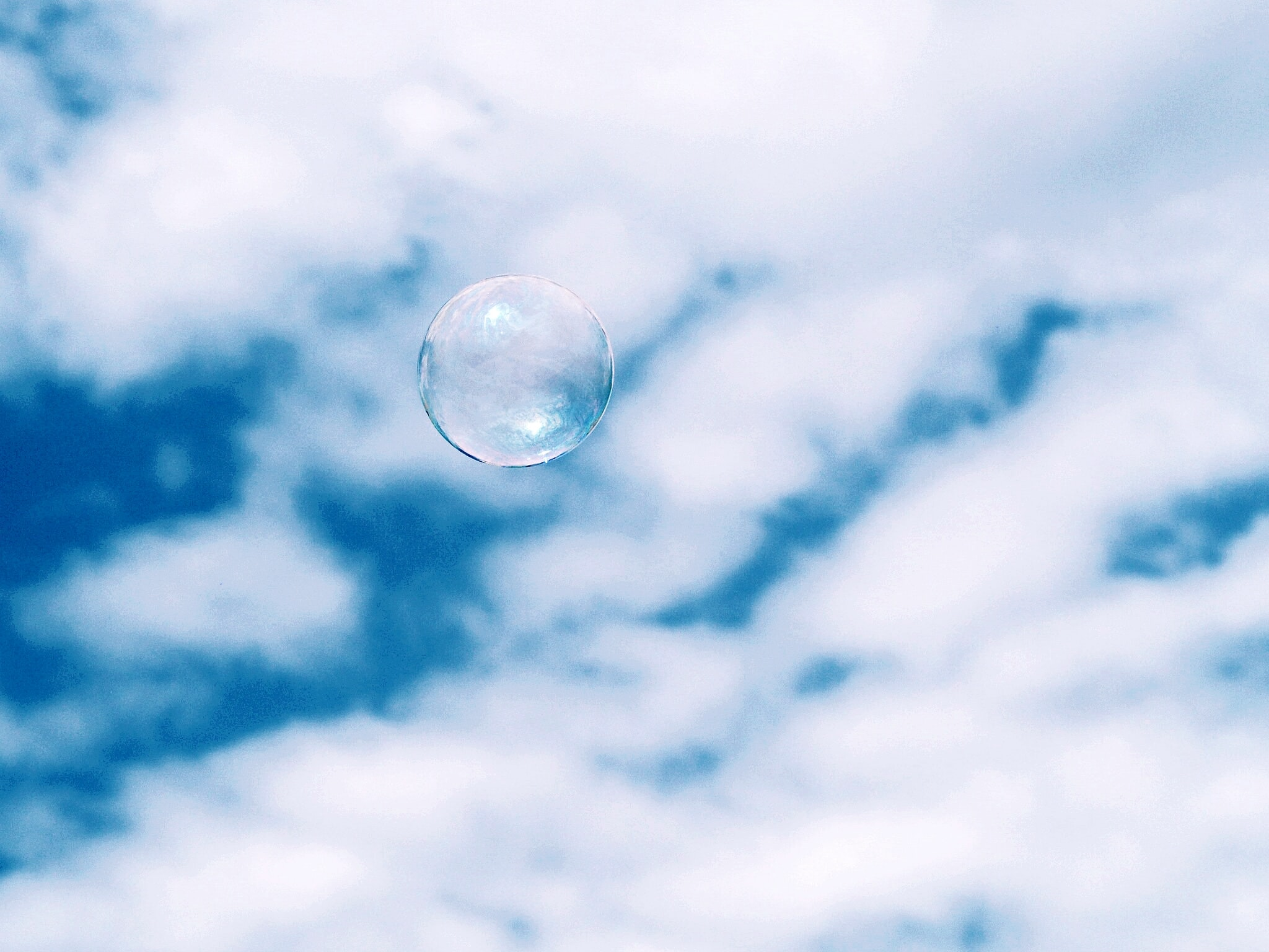 bubble under white clouds at daytime
