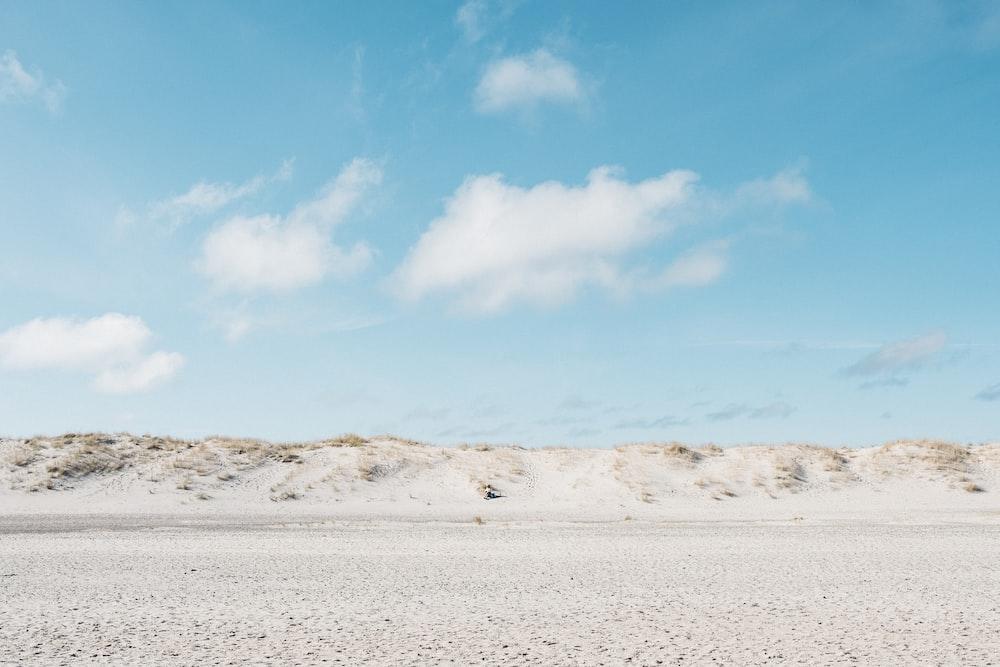 white plain under blue sky at daytime