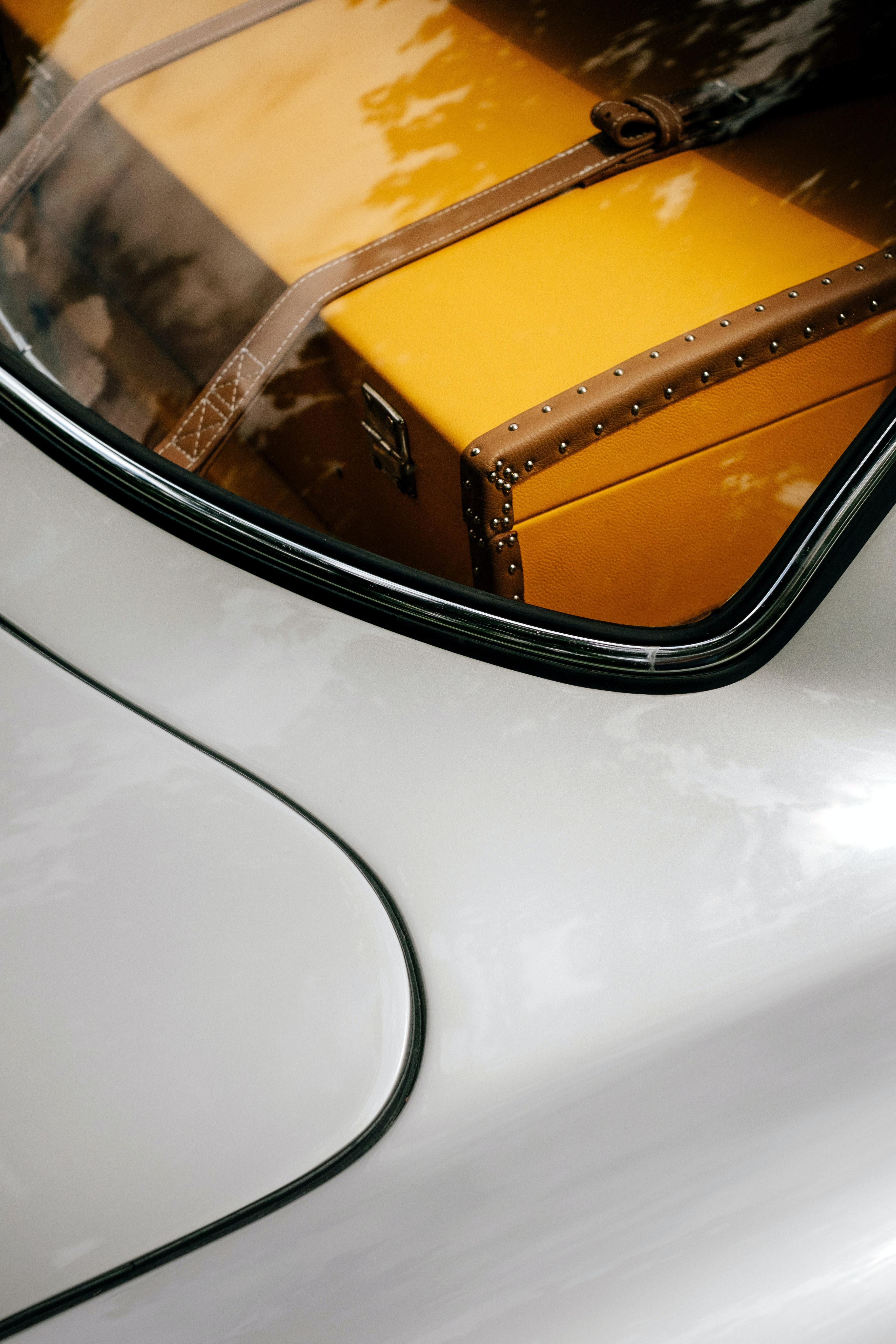 brown chest box inside silver car