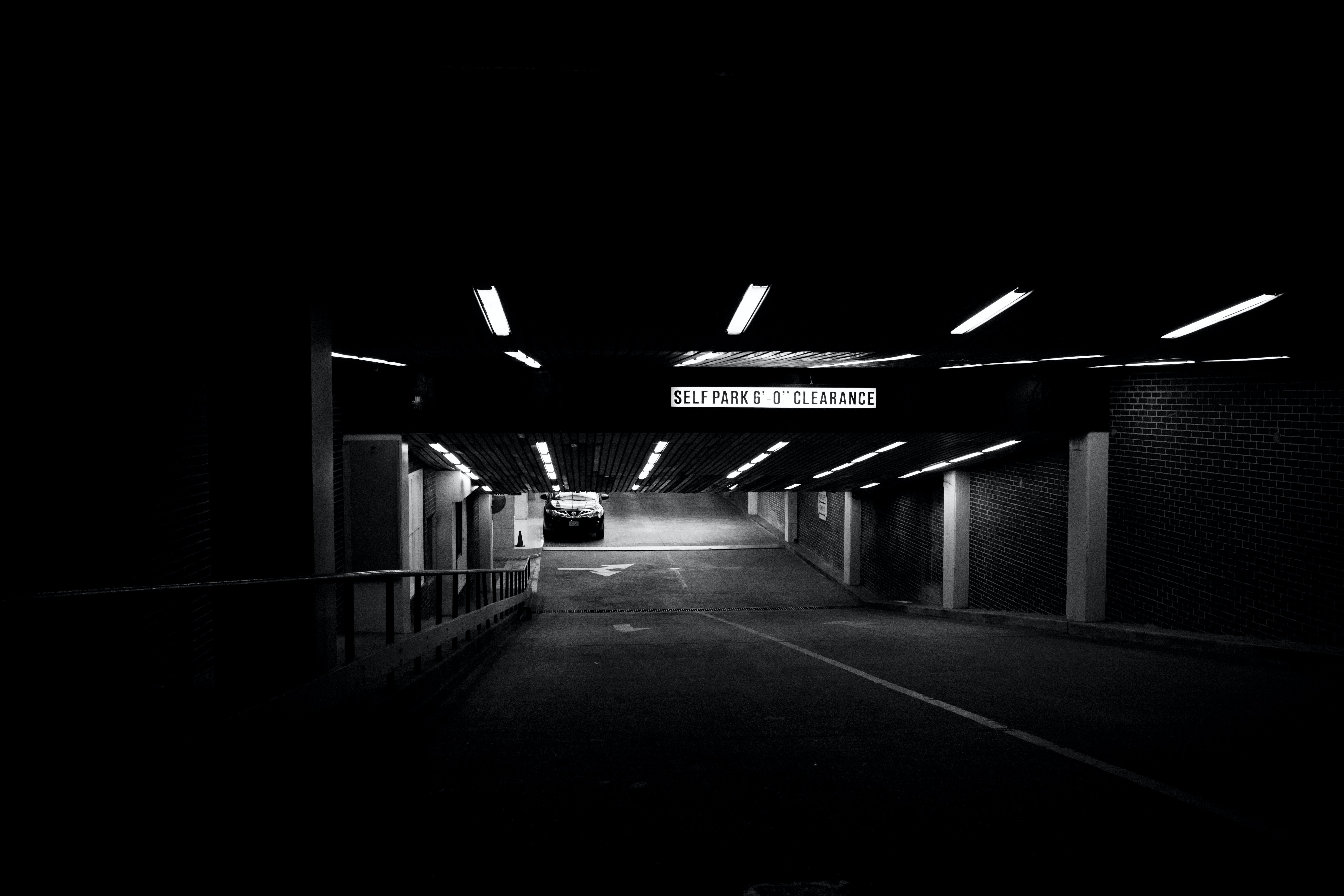grayscale photo of parking area