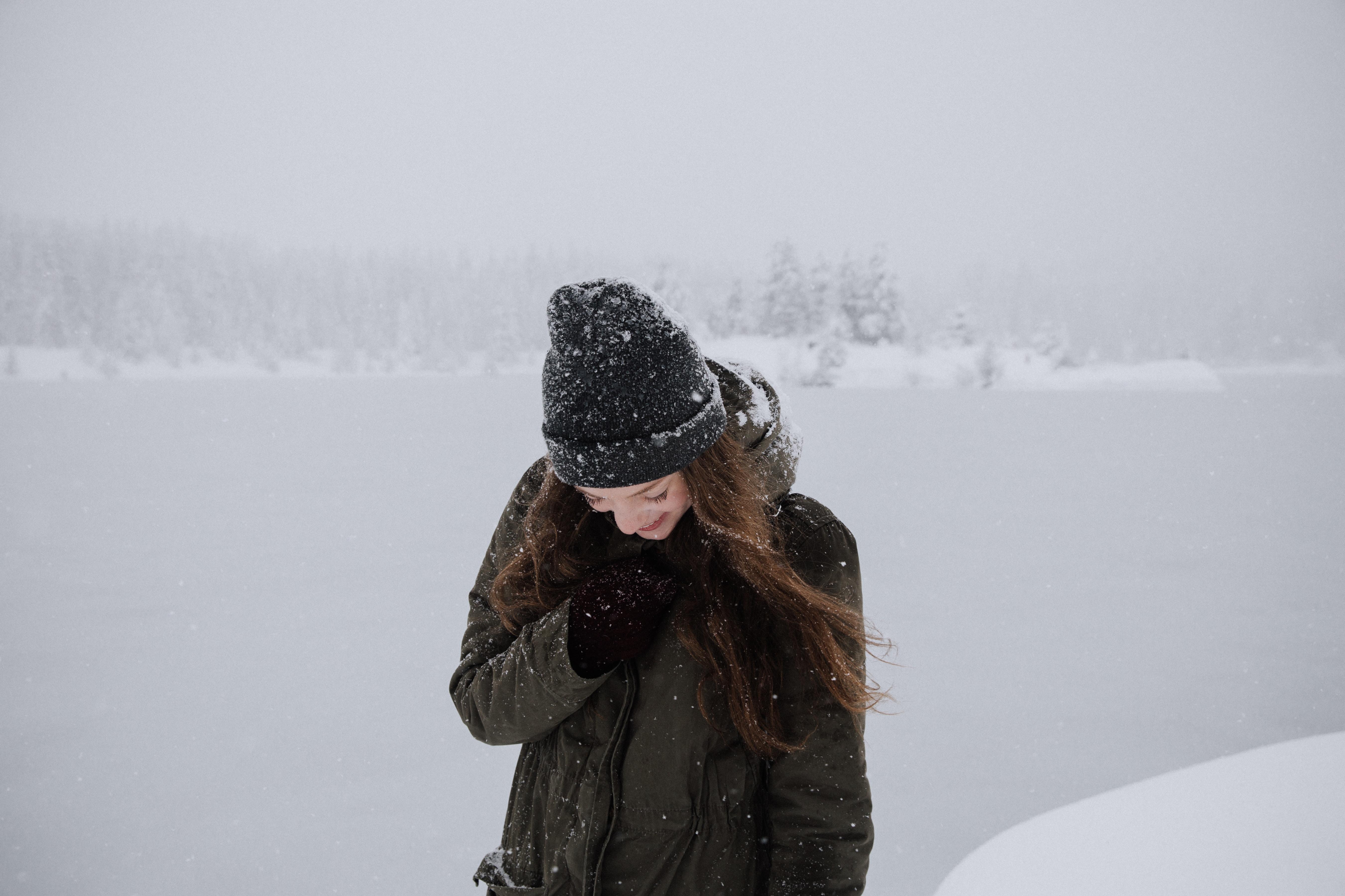 closeup photo of woman wearing black coat during winter