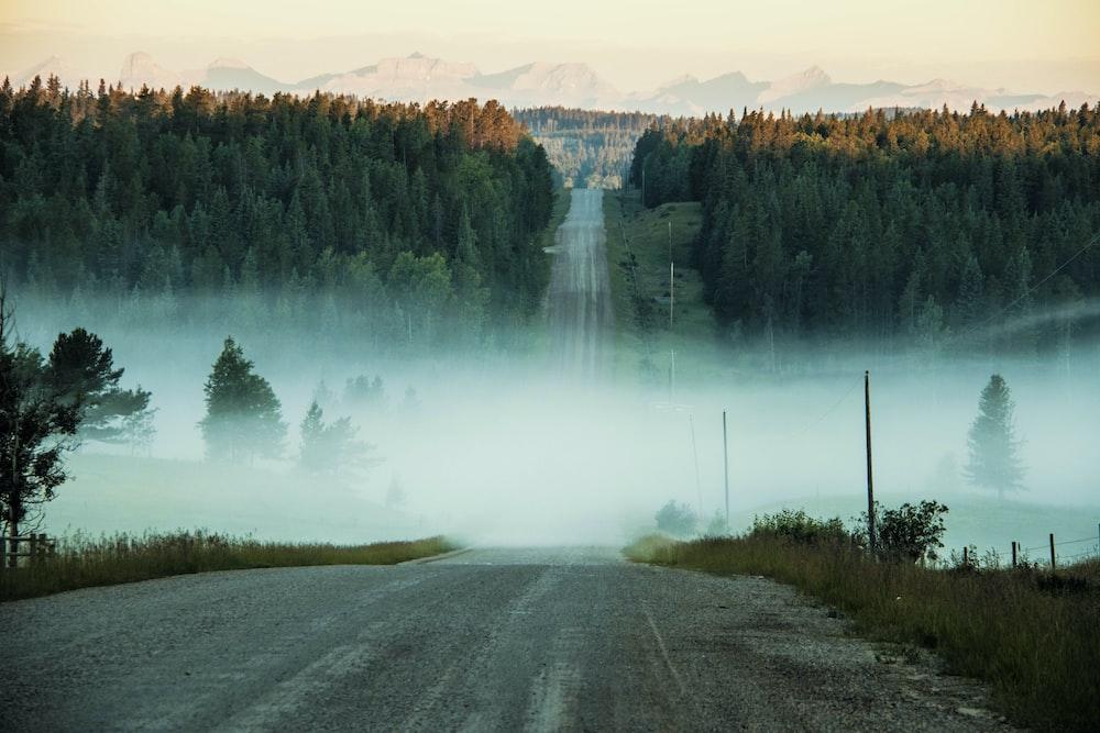 photo of concrete road towards mountain
