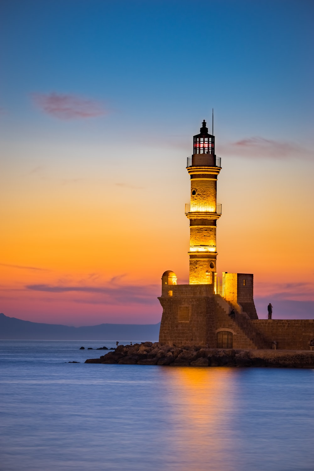 brown lighthouse during golden hour