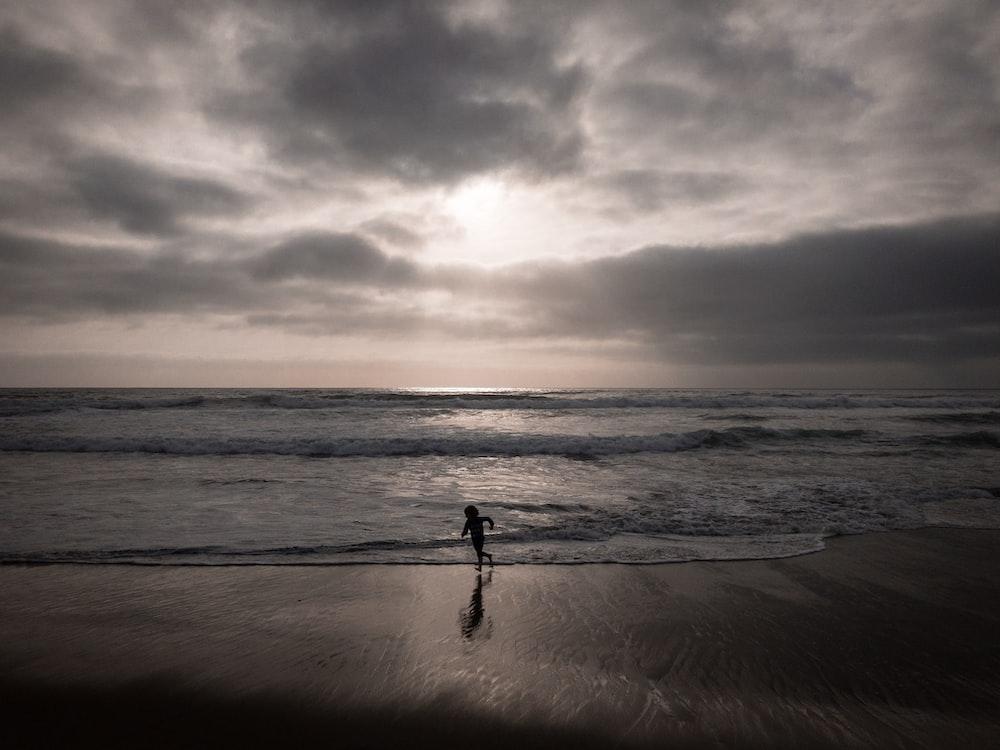 silhouette of person near beach