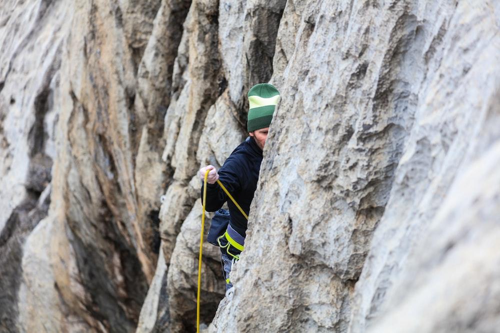 man doing wall climb activity