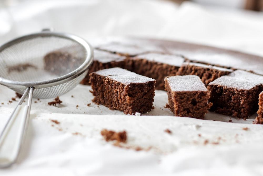 slice of brownies beside silver strainers