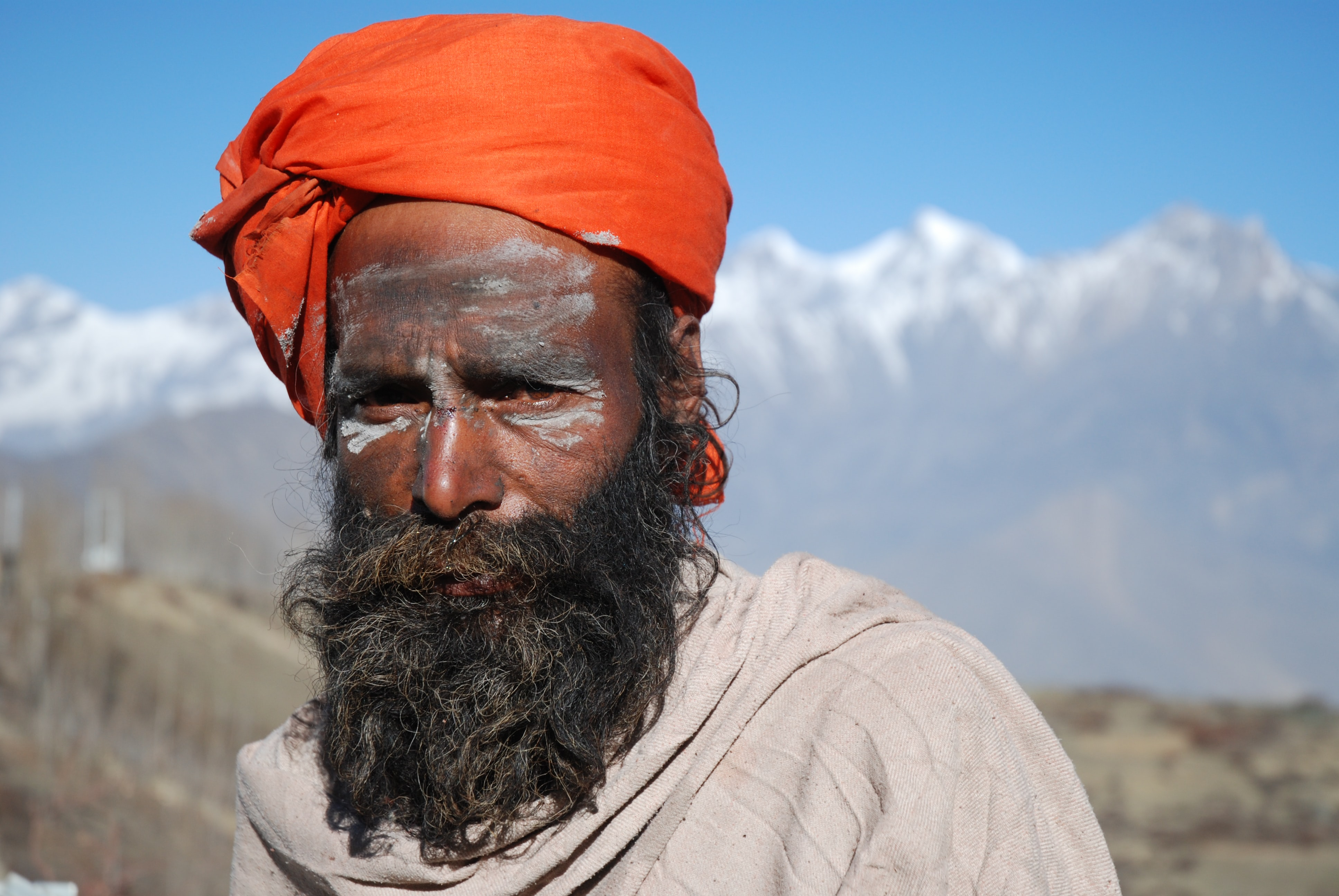 man wearing orange turban and gray top